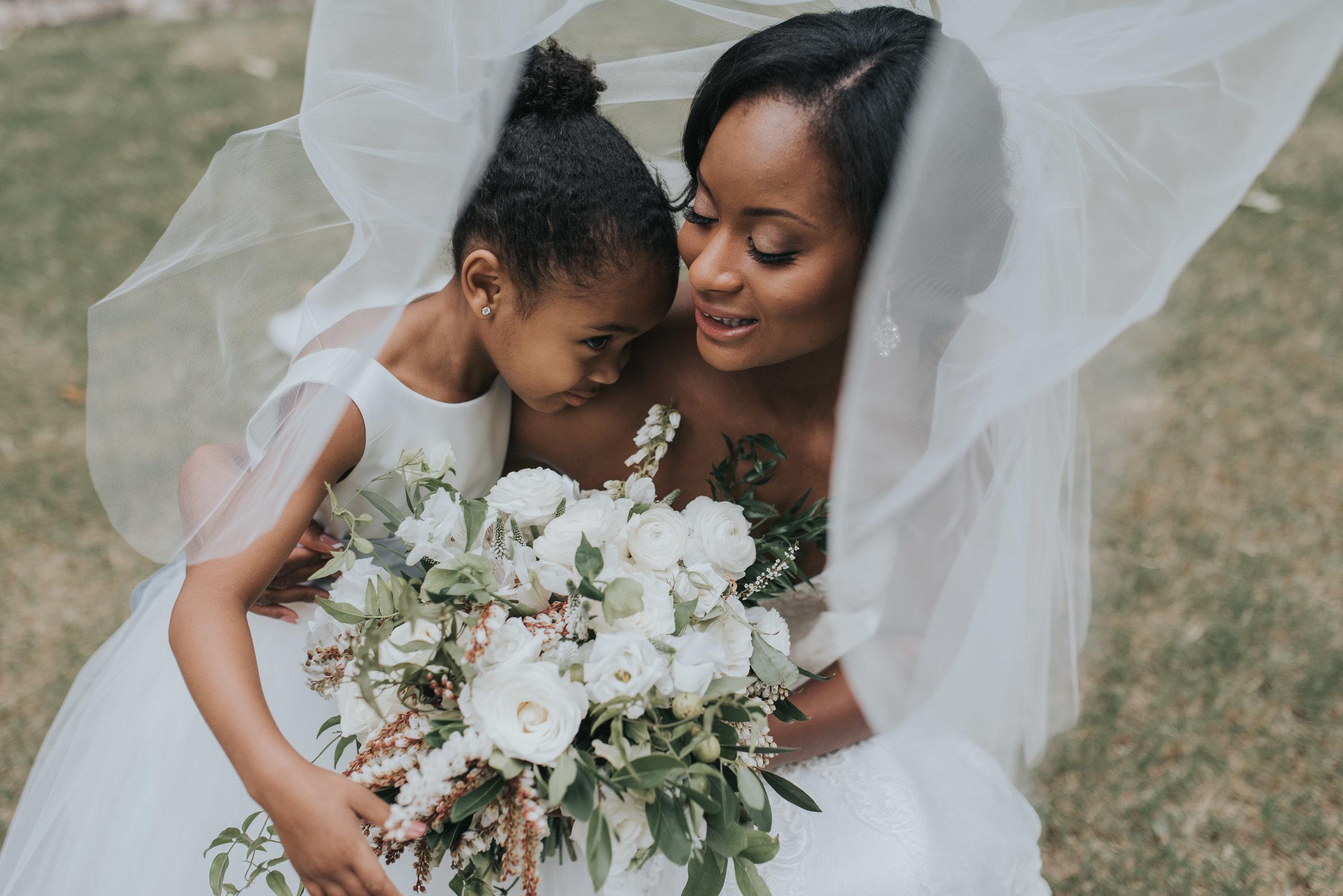 Bride and daughter hug before wedding at Swan House in Atlanta, GA