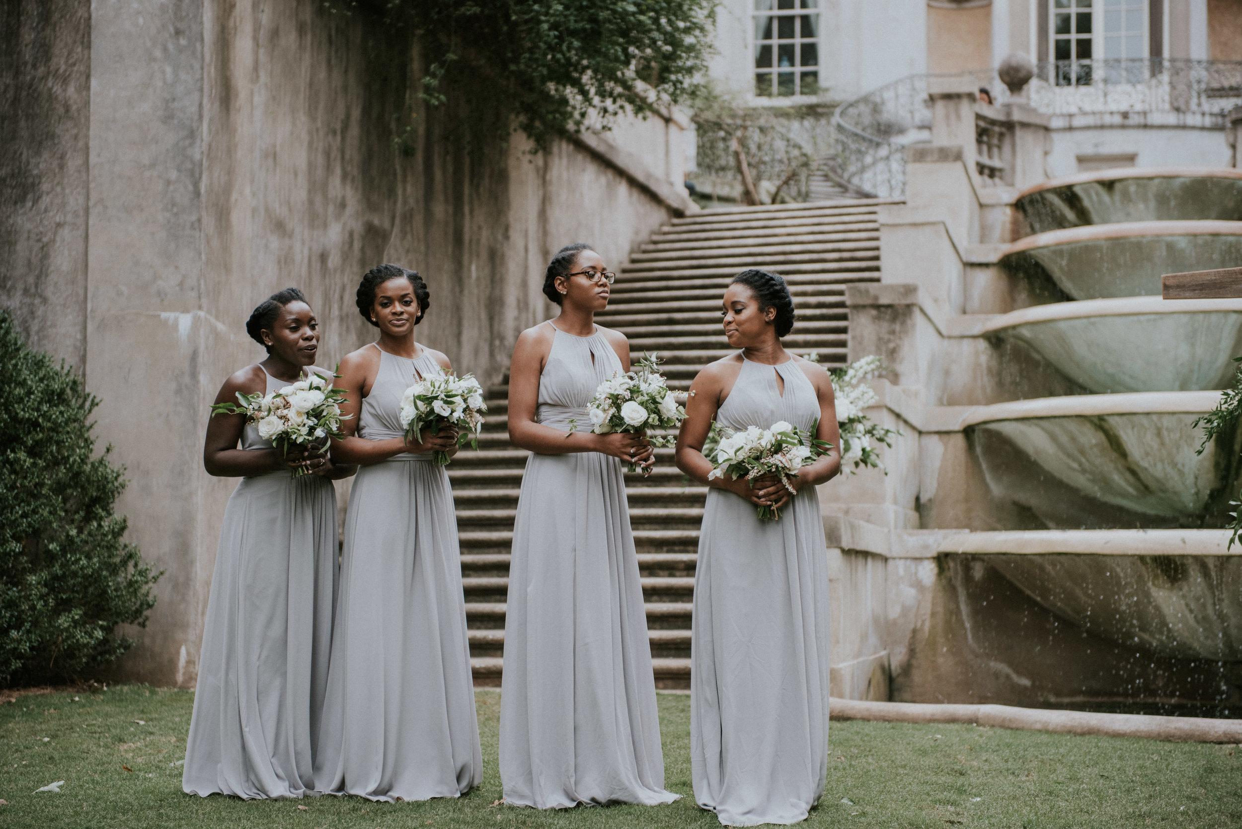 Bridesmaids at wedding ceremony on Swan House lawn in Atlanta, GA
