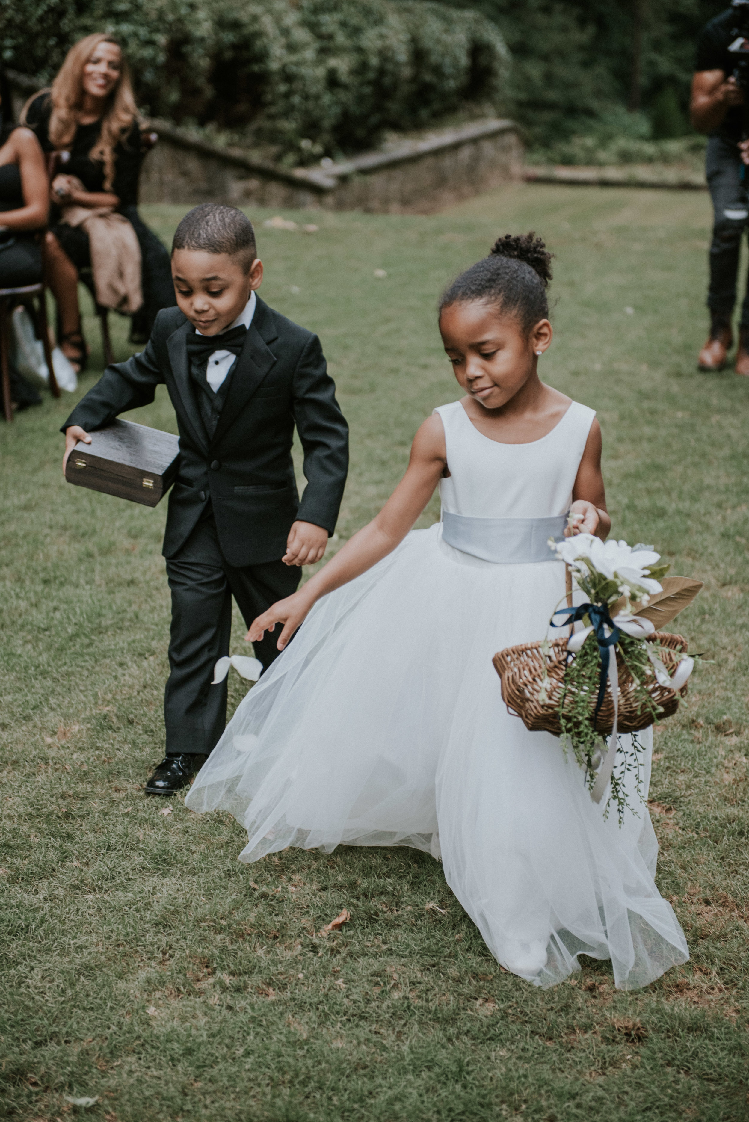 Ring bearer and flower girl walk down the aisle at Swan House in Atlanta, Ga