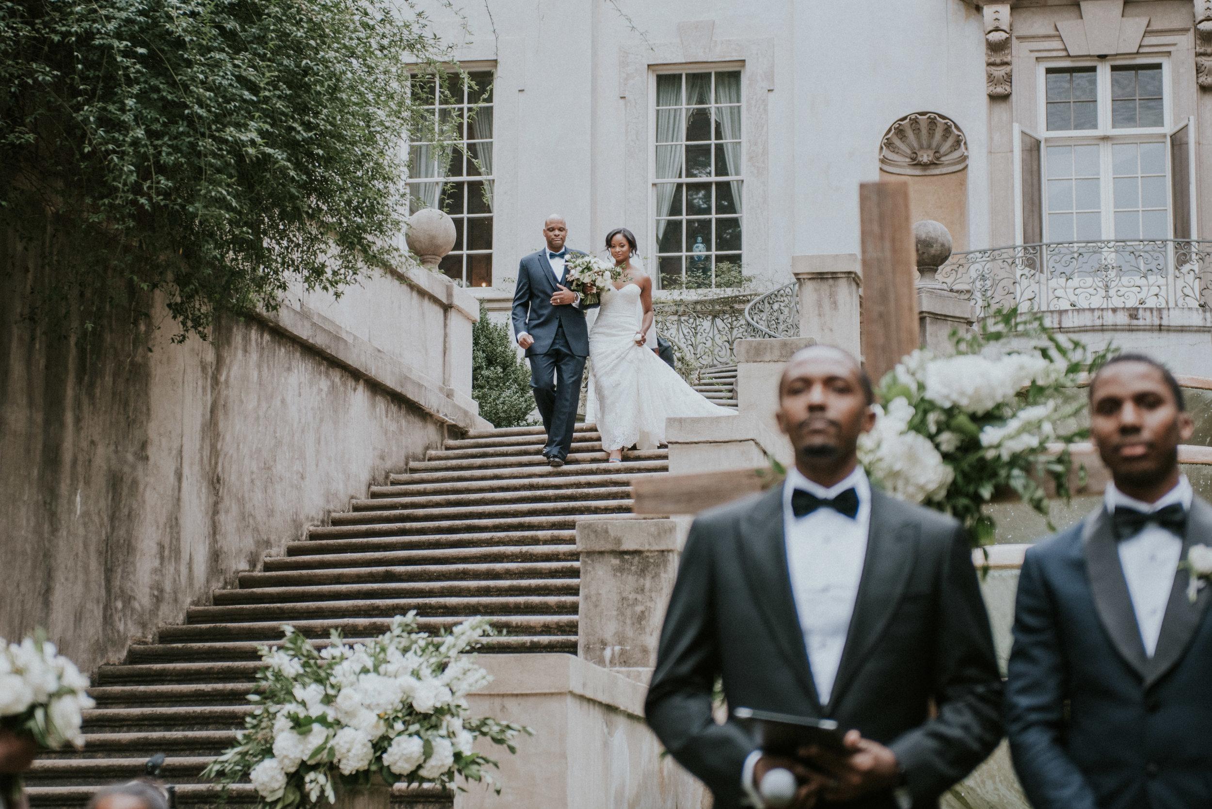Bride walks down Swan House stairs in Atlanta, GA