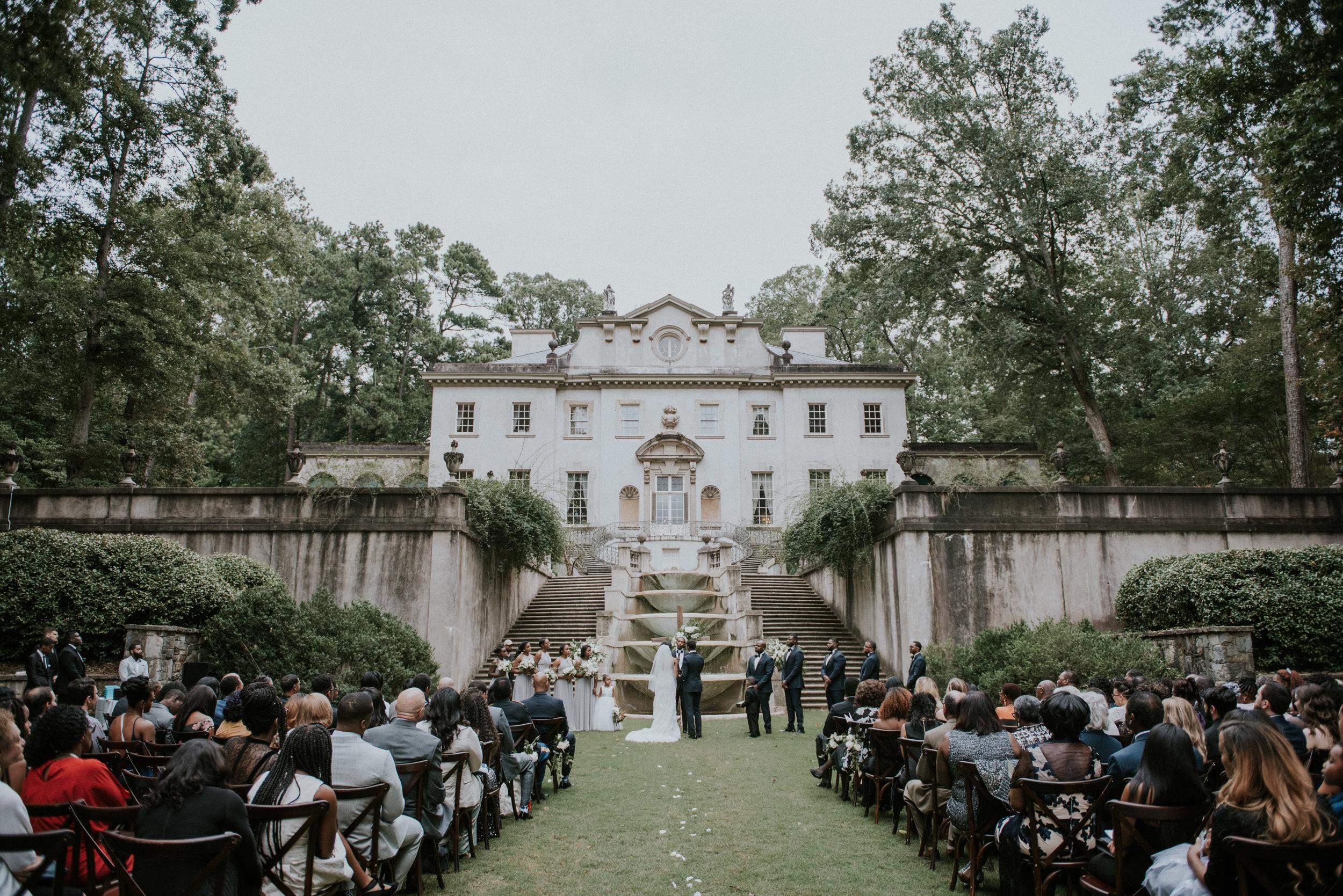 Wedding ceremony on lawn at Swan House in Atlanta, GA