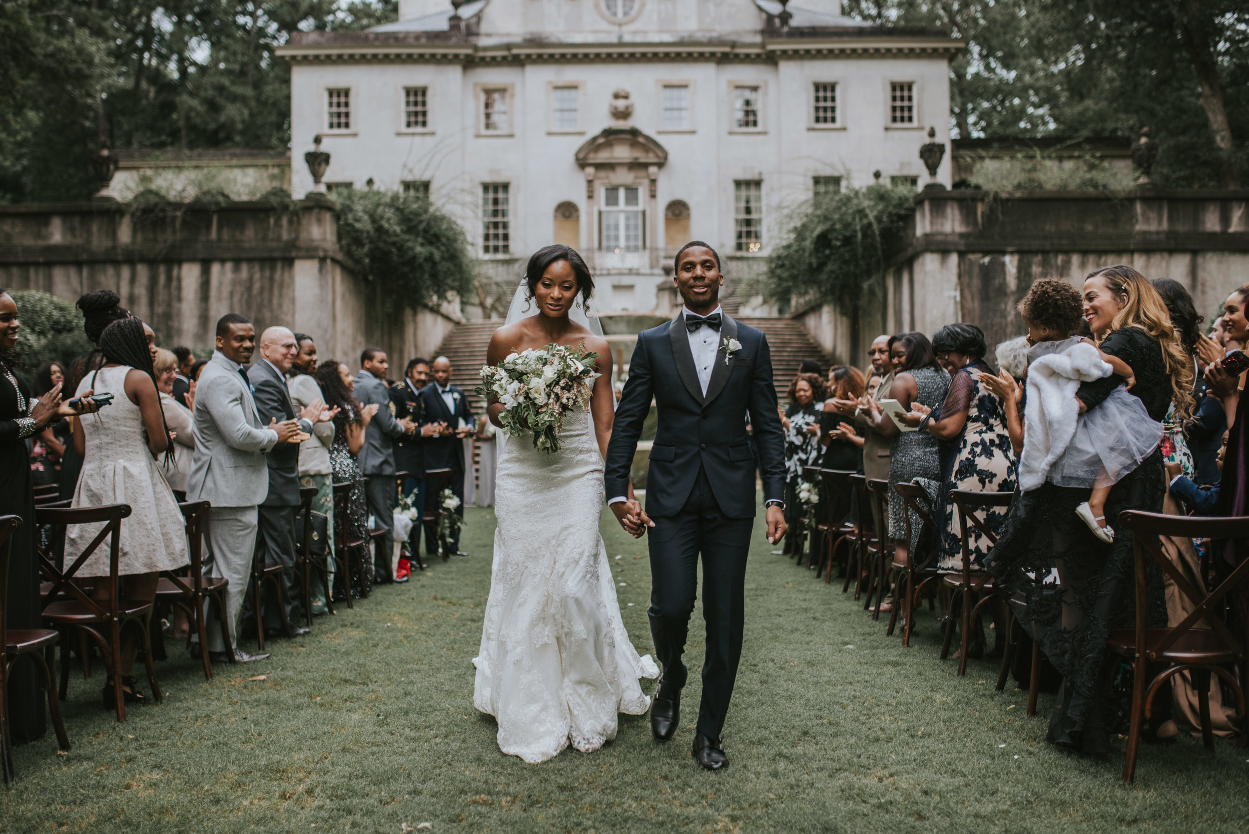 Bride and groom walk up aisle at Swan House in Atlanta, GA