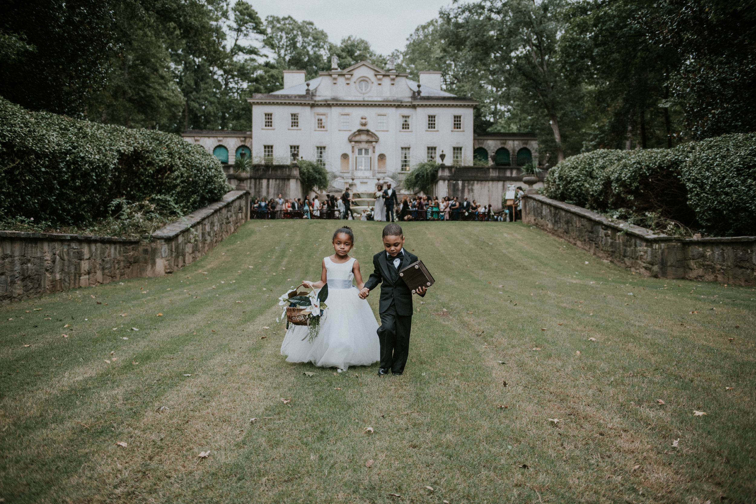 Flower girl and ring bearer with Swan House in the background in Atlanta, GA