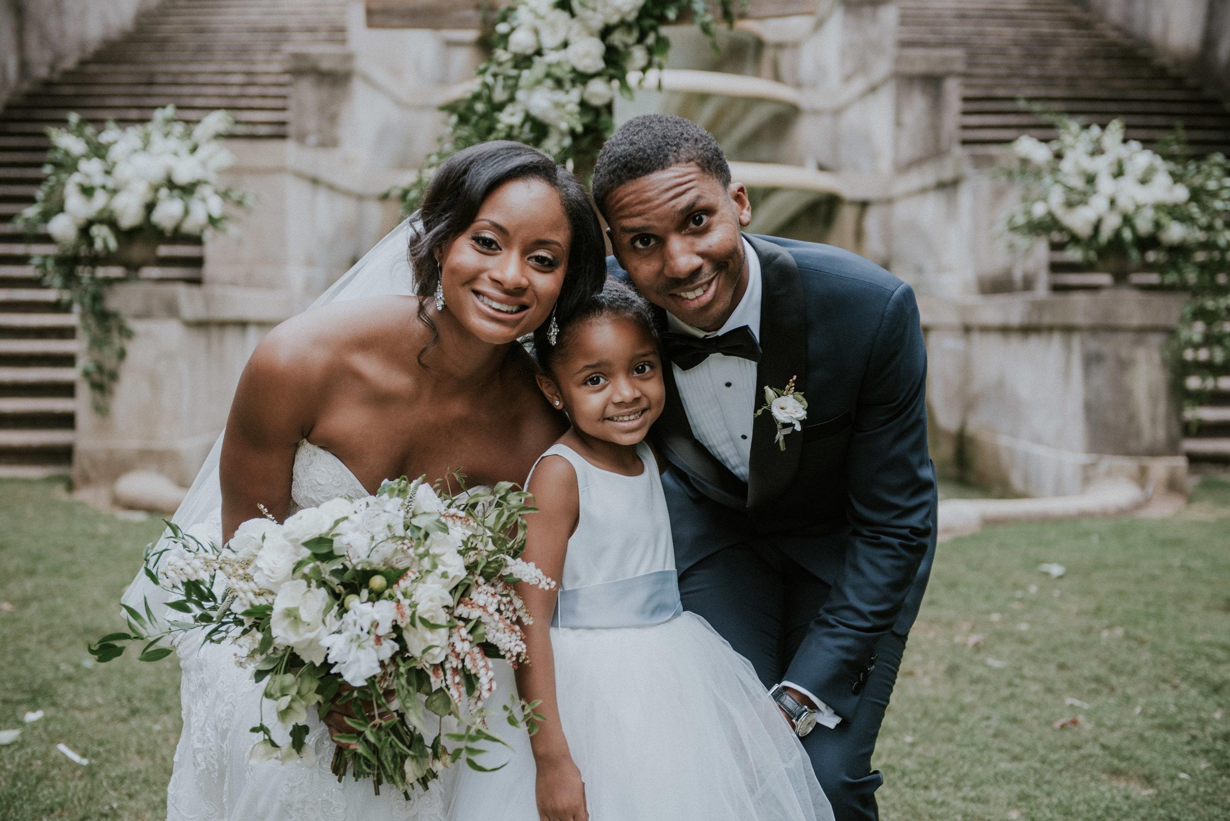 Newlyweds with daughter at Swan House in Atlanta, GA