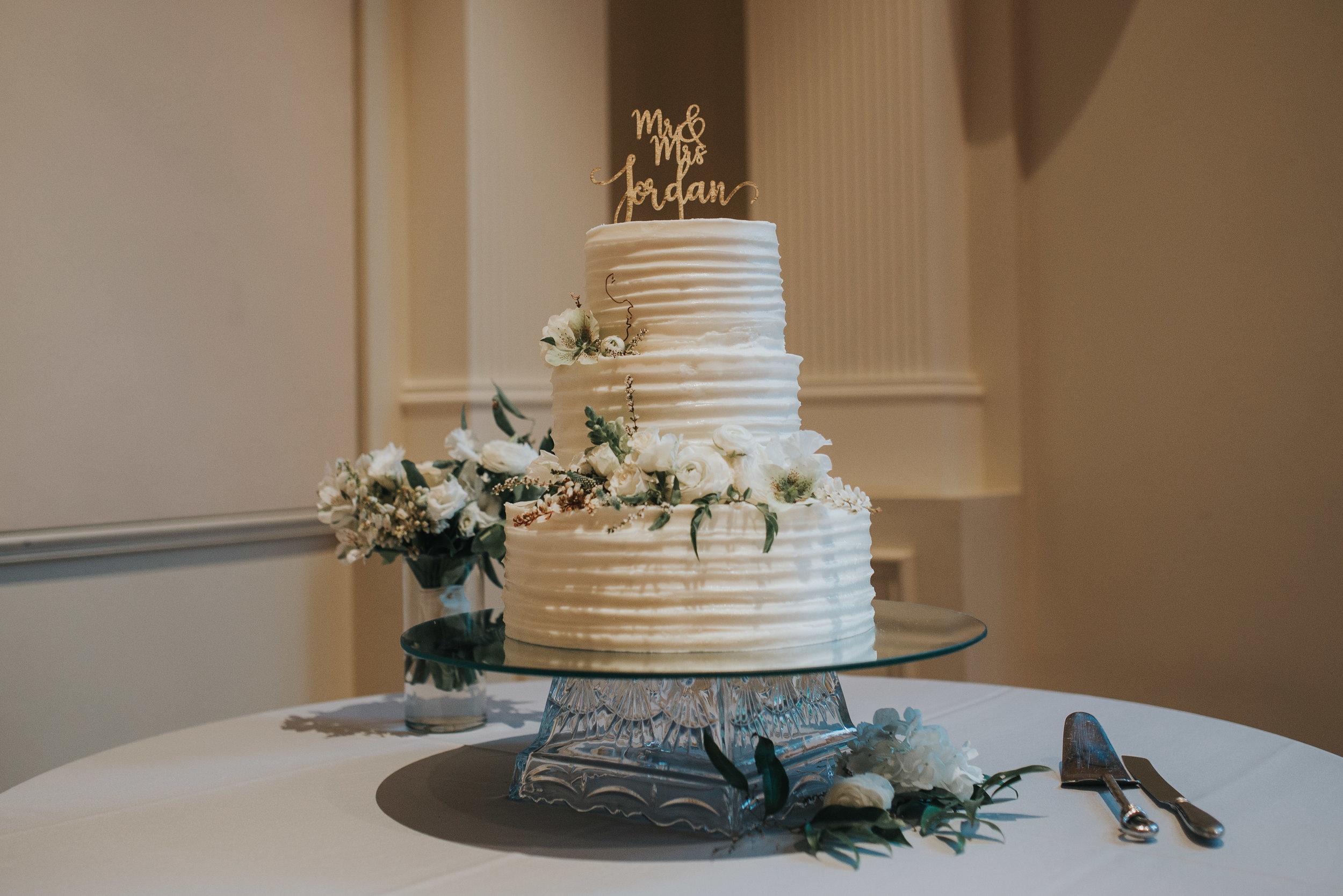 Wedding cake with eucalyptus accents