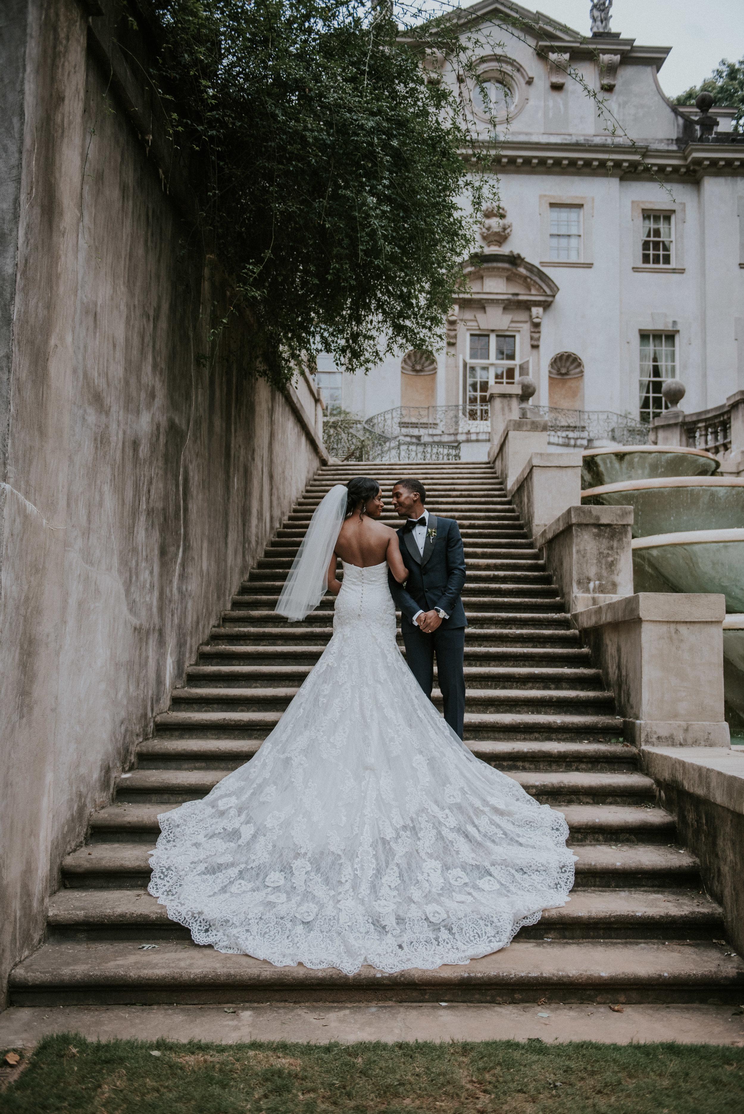 Bride's Martina Liana wedding dress on Swan House steps
