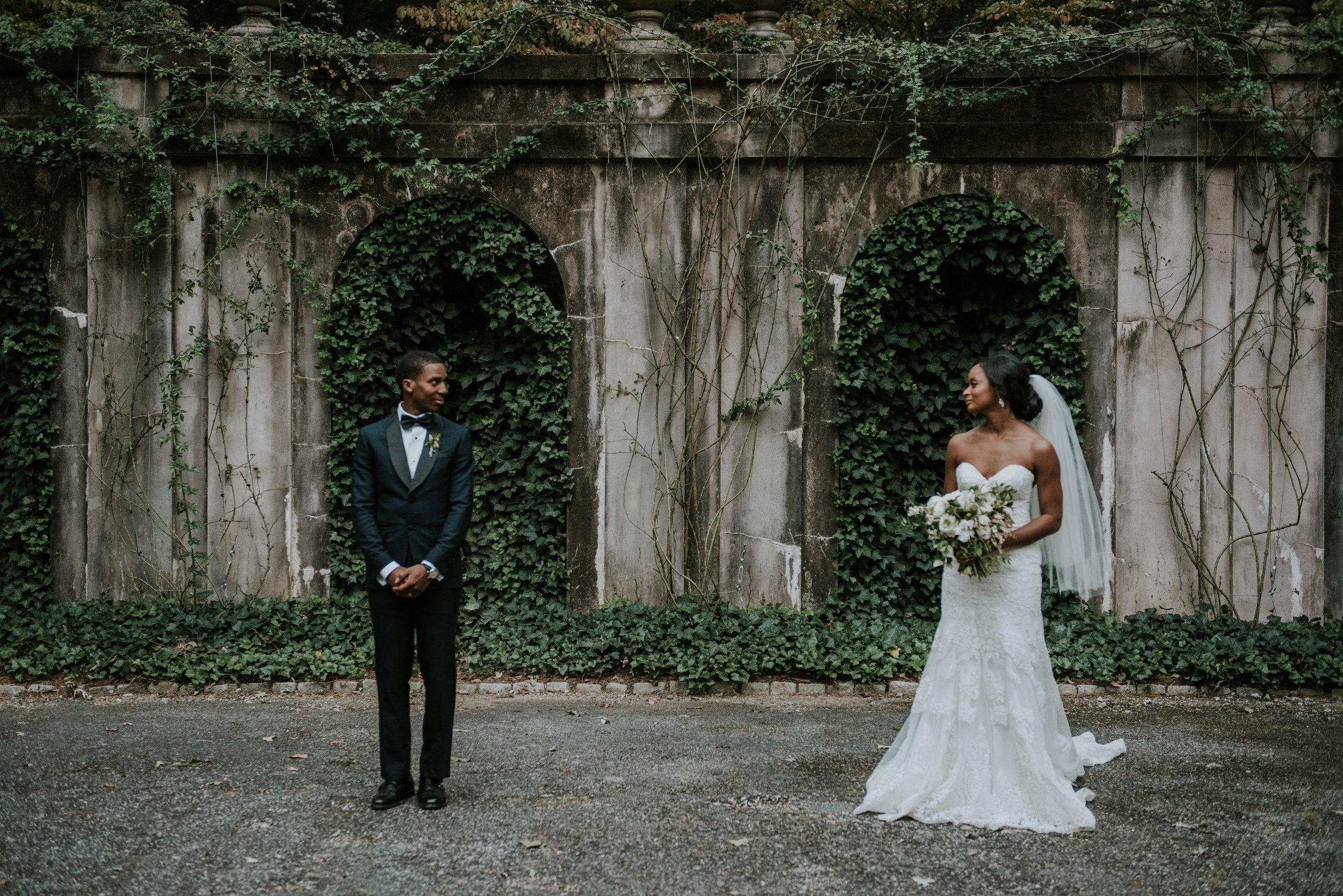 Bride and groom spaced apart at Swan House in Atlanta, GA