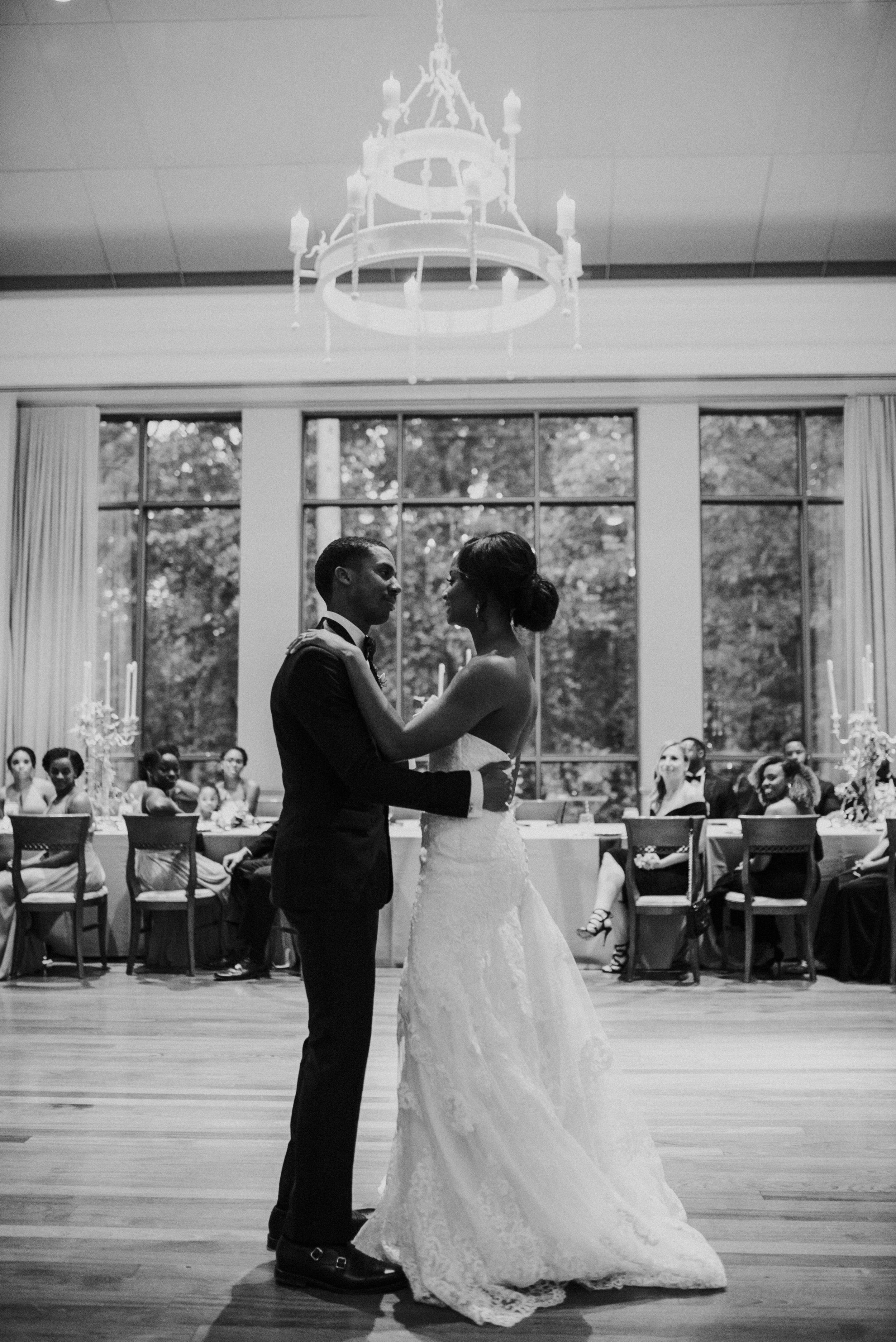 Bride and groom dance under chandelier at Atlanta History Center