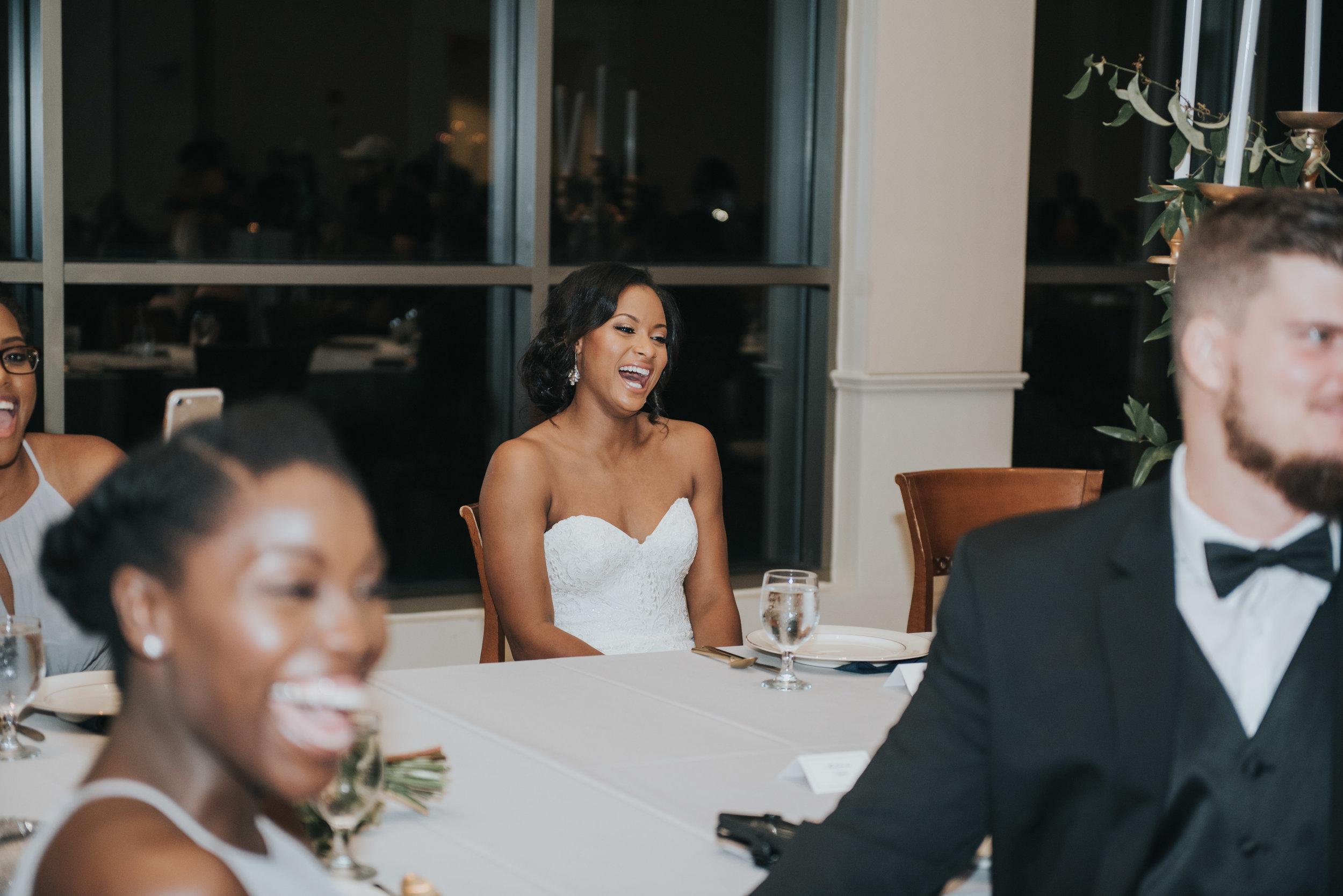 Bride laughing during wedding reception at Atlanta History Center