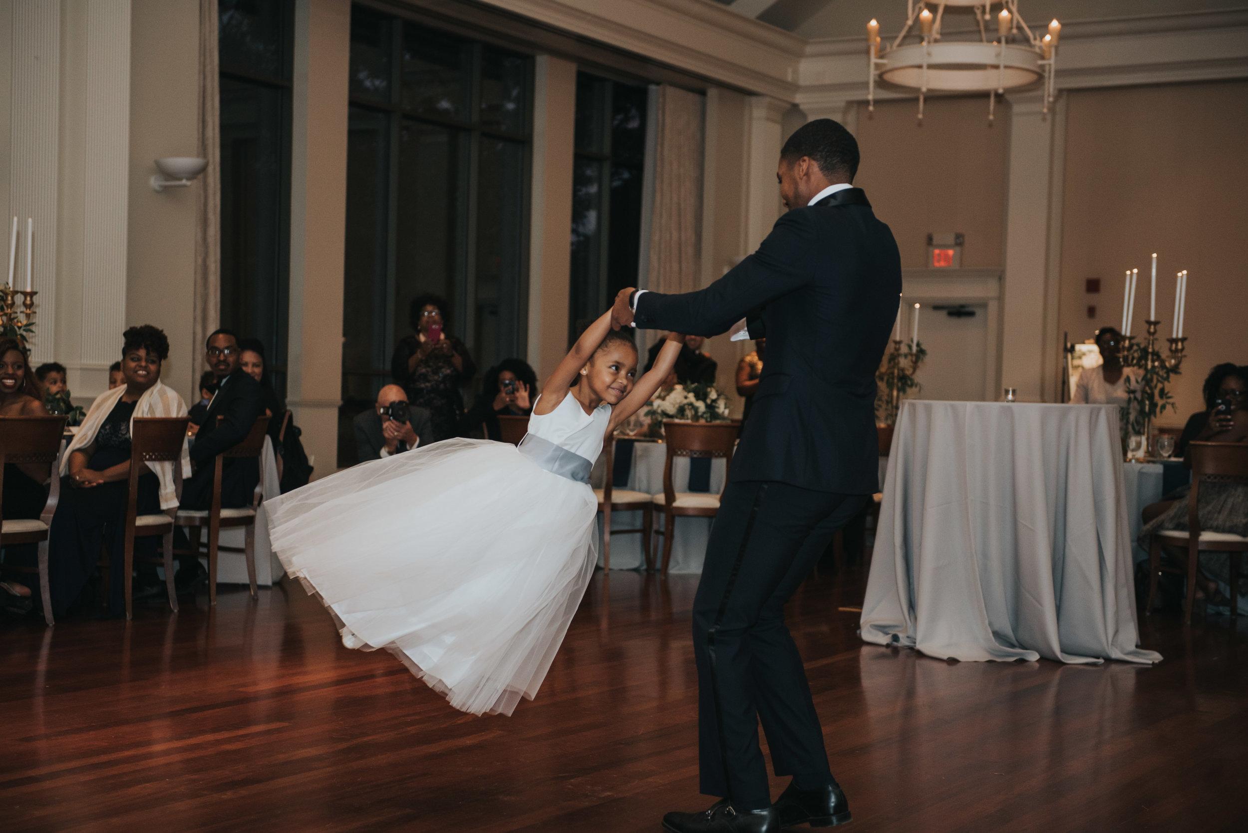 Groom twirling daughter at wedding reception Atlanta History Center