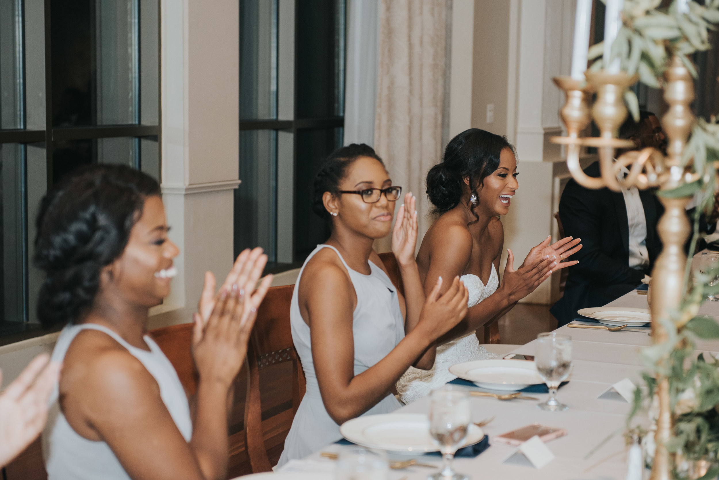 Bridesmaids clapping during wedding reception