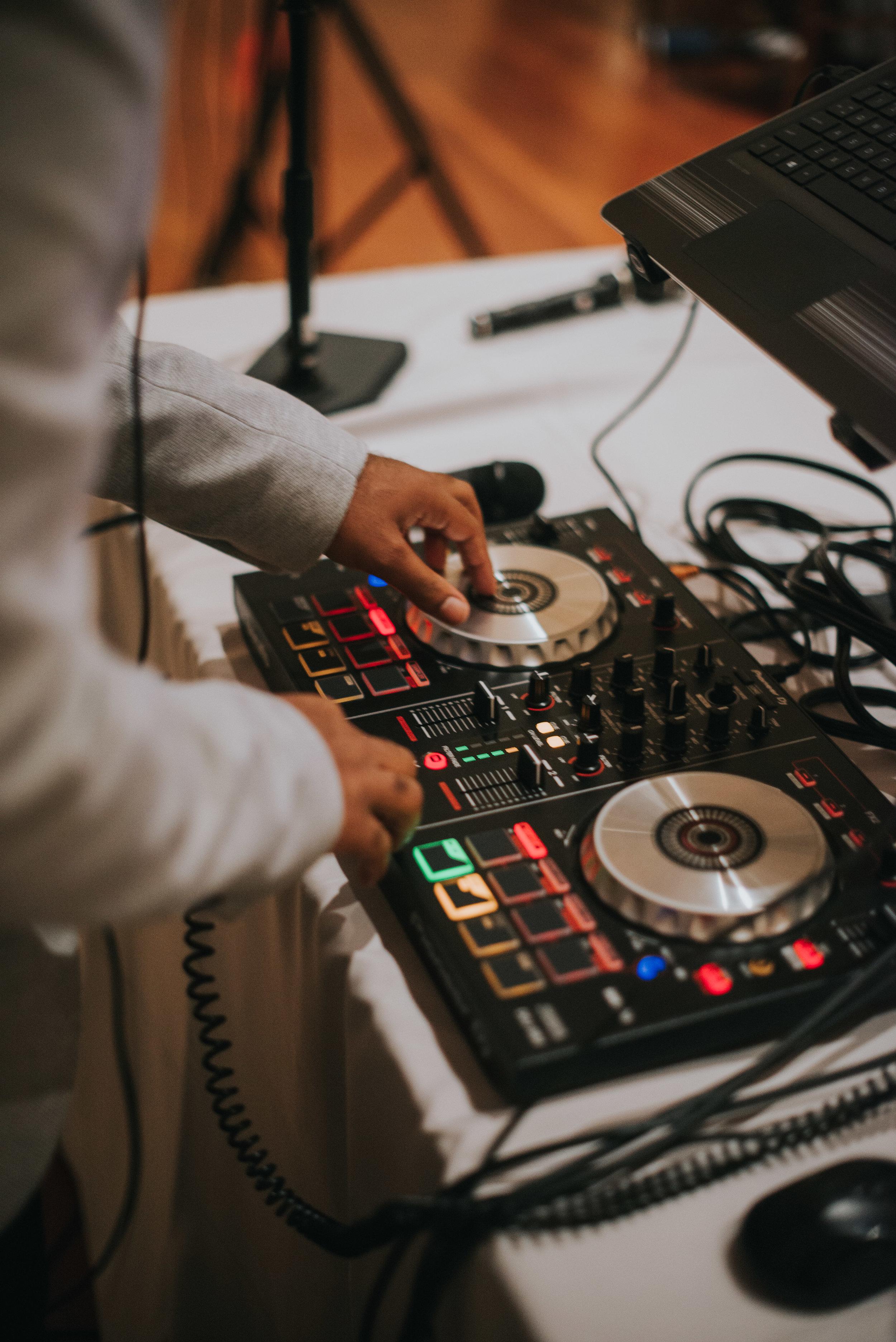 DJ adjusting soundboard