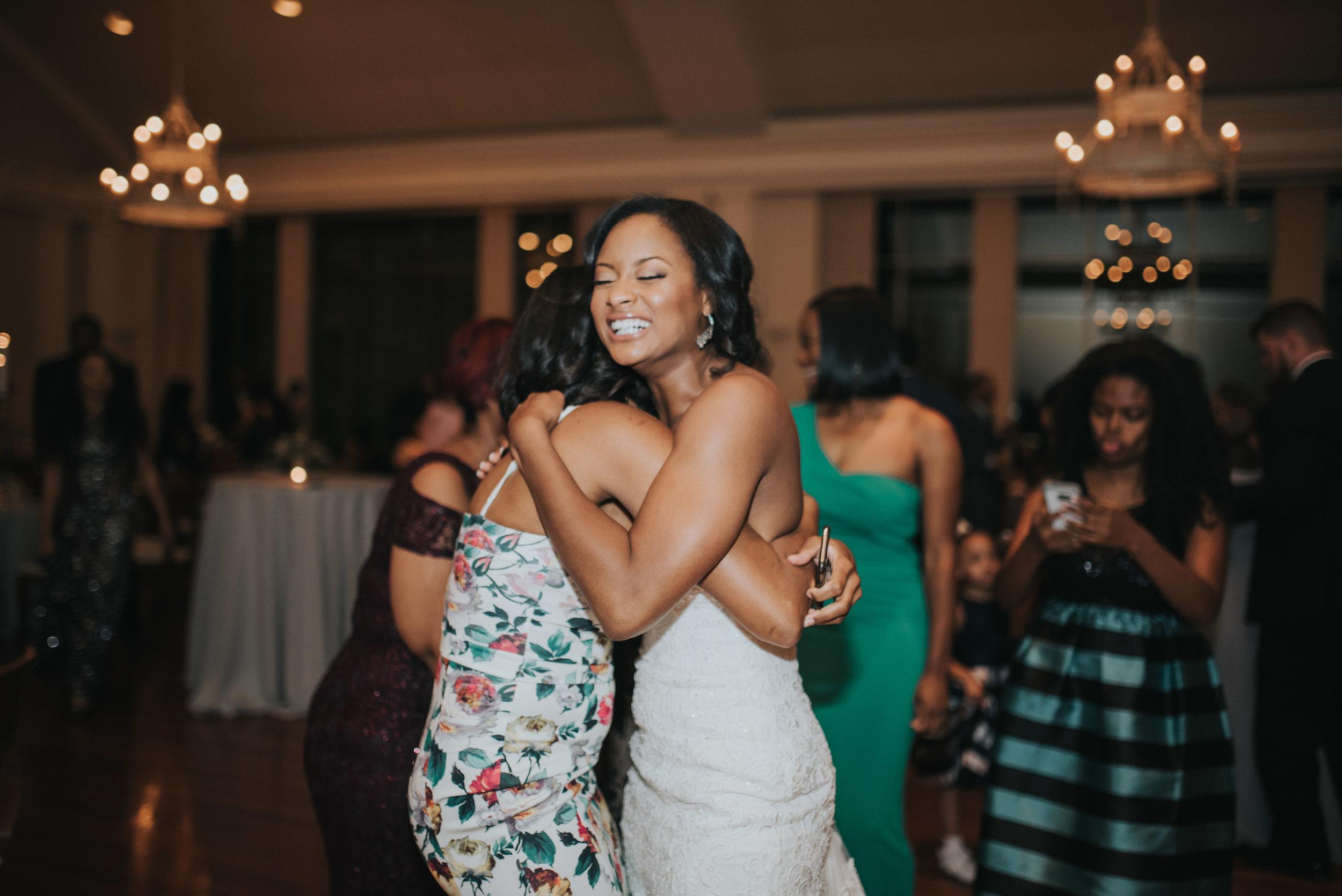 Bride hugging guest of wedding