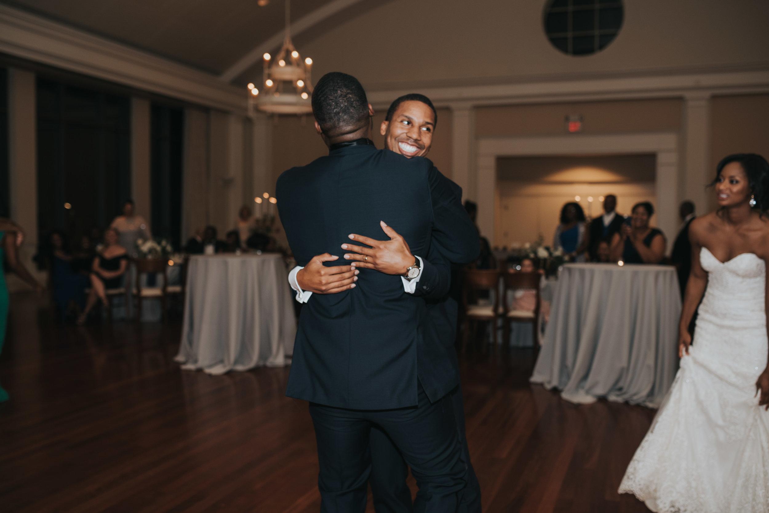 Groom hugs guest goodbye