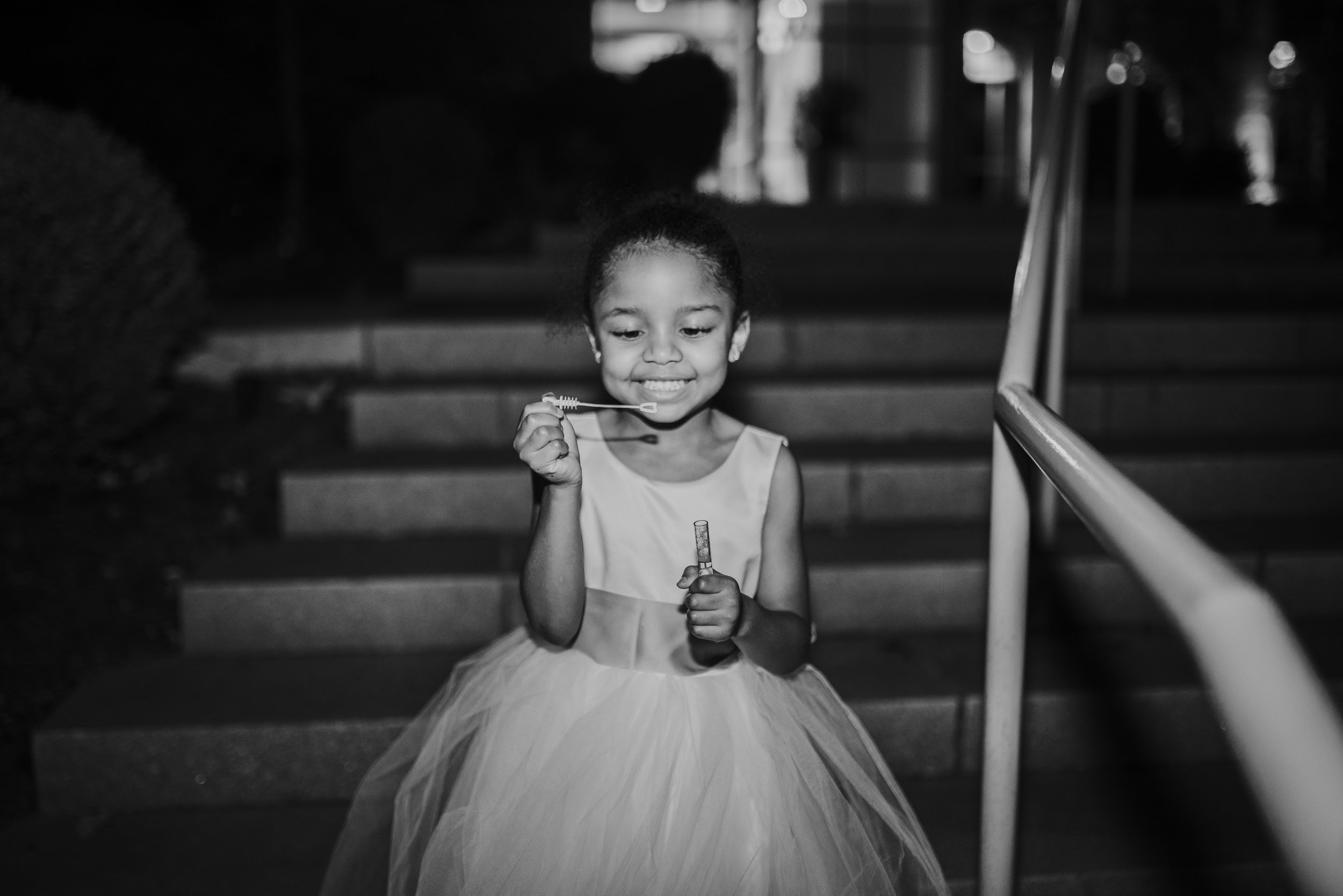 Flower girl blowing bubbles during grand exit