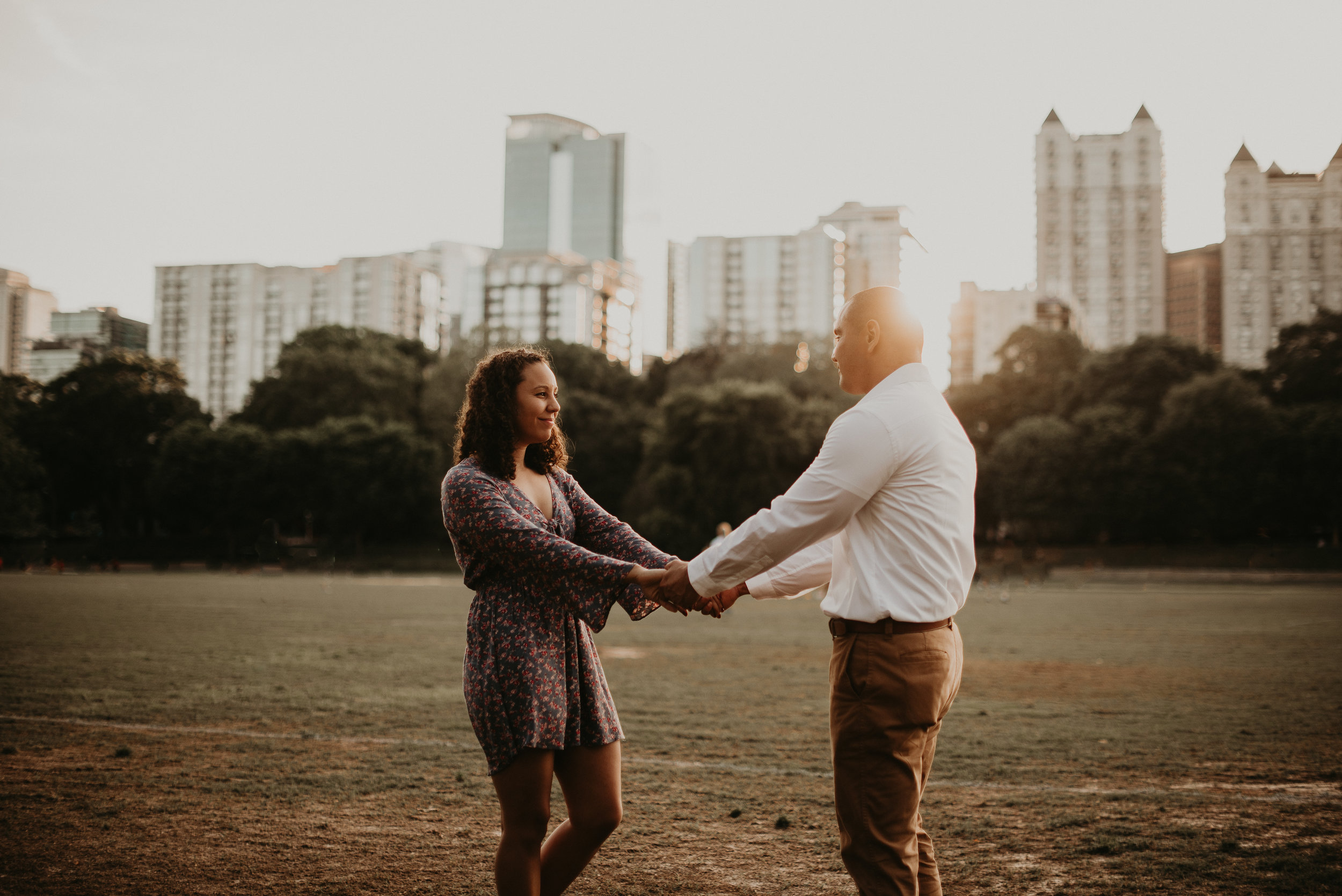 couple holding hands at sunet in piedmont park atlanta