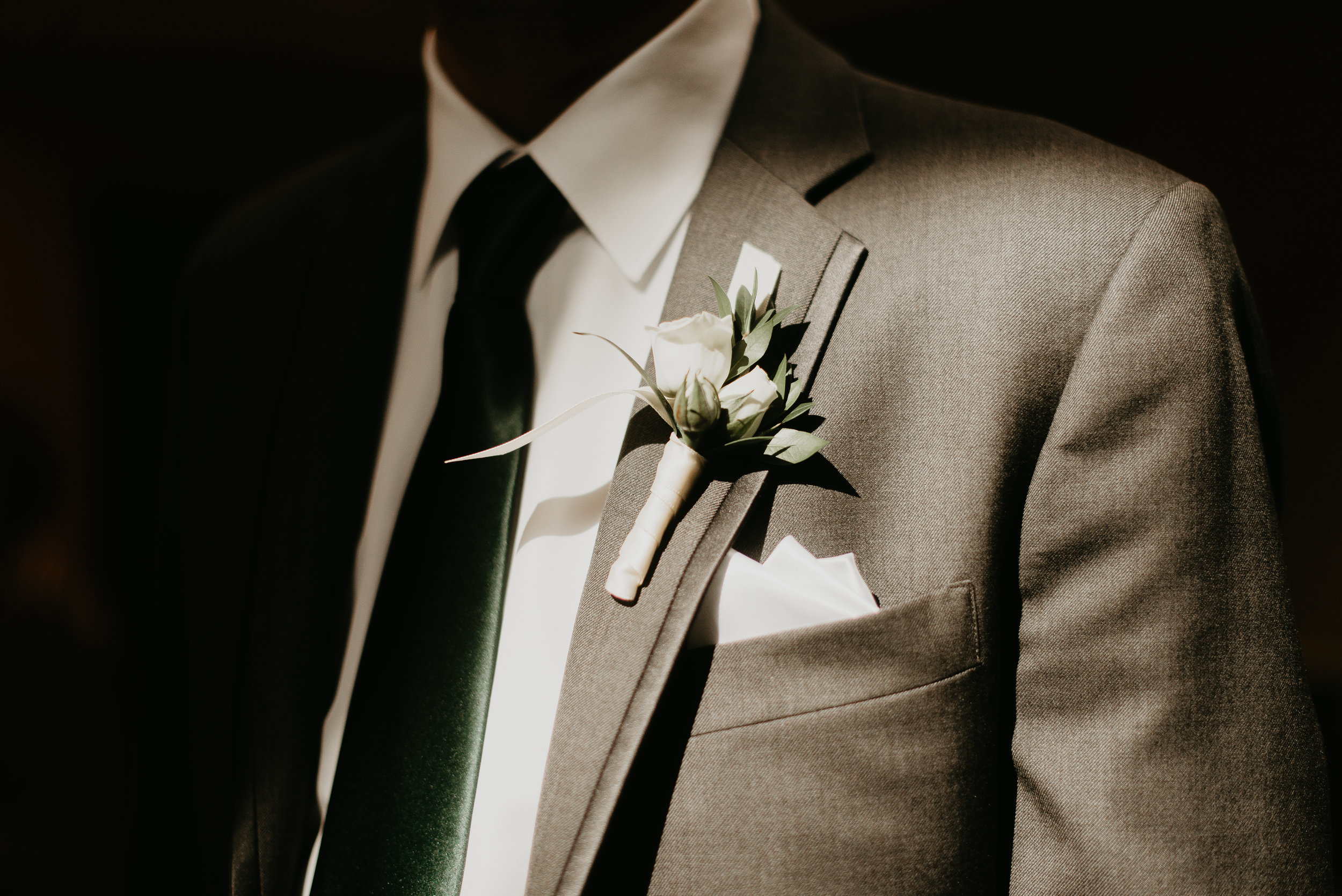 Groomsmen boutonniere with moody tones