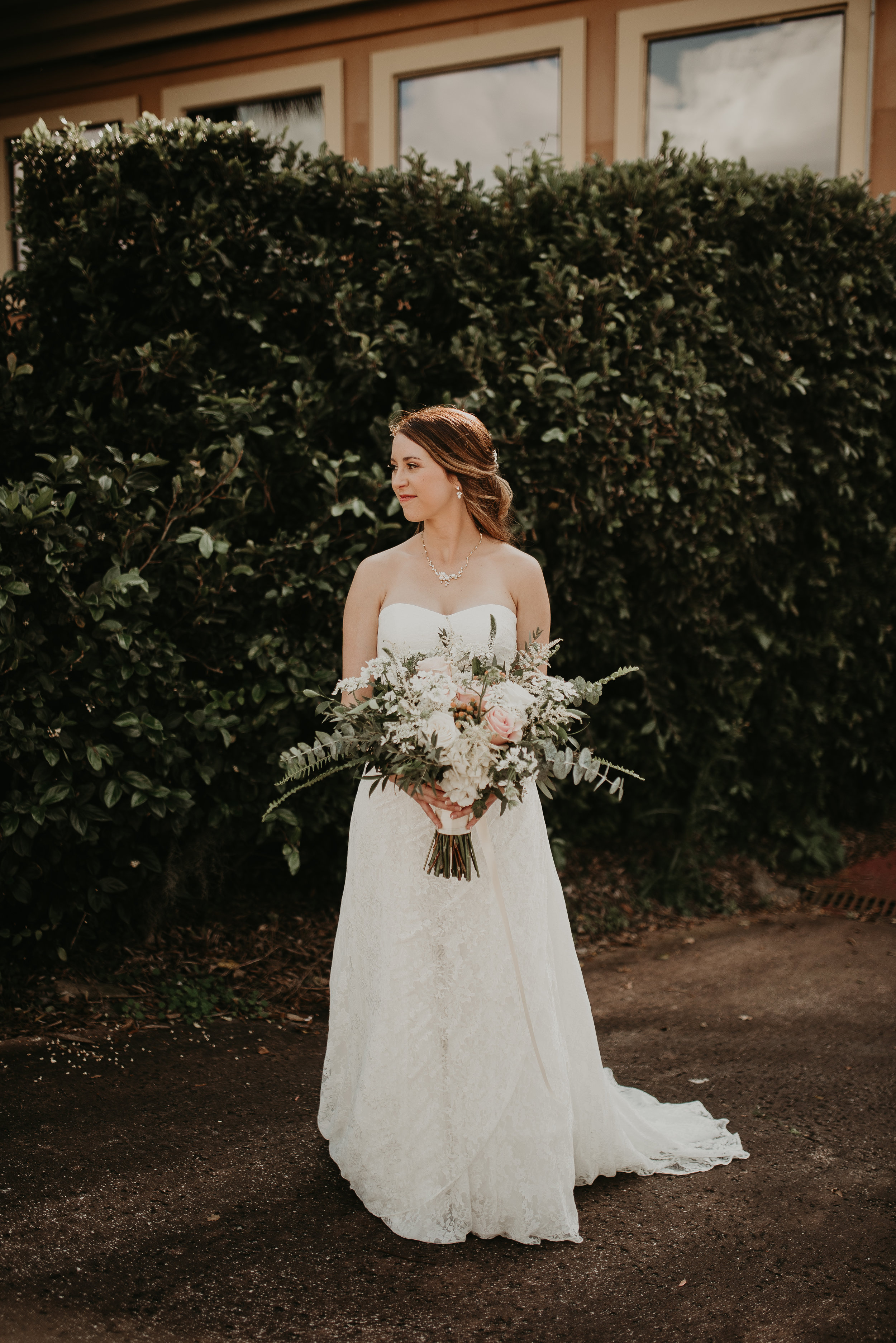 Portrait of bride with large wildflower bouquet