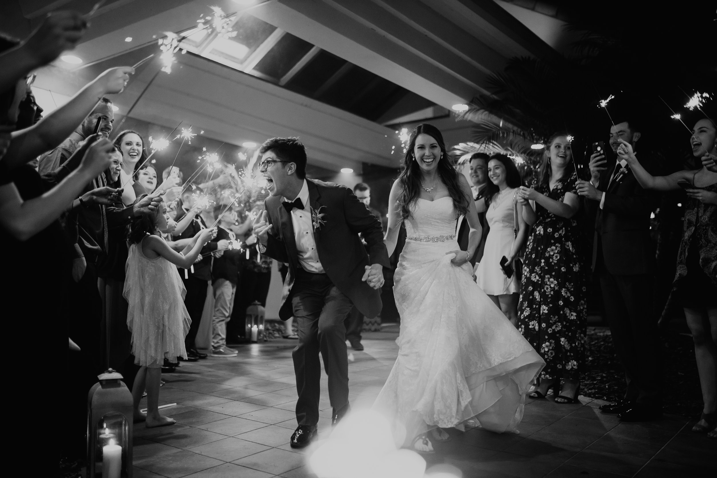 Bride and groom smiling and laughing during sparkler exit at MetroWest Golf Club in Orlando, FL