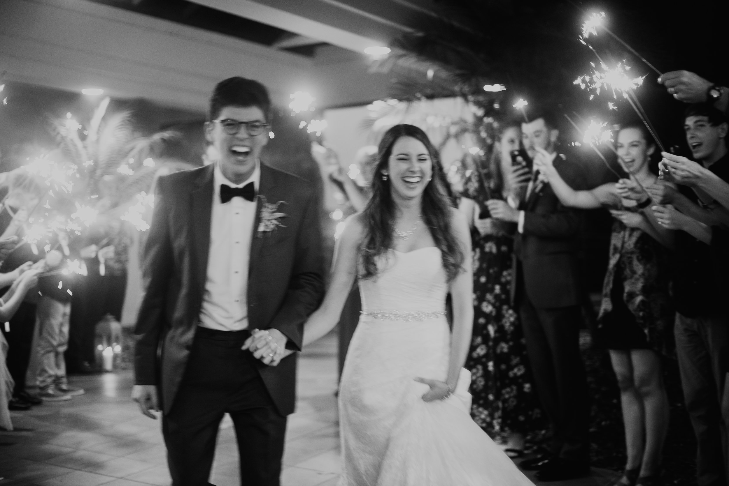 Newlyweds joyful during sparkler exit at MetroWest Golf Club