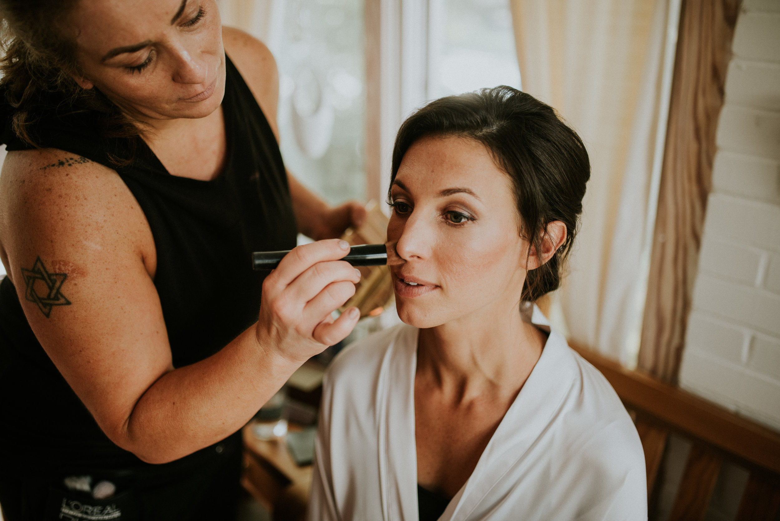 Bride with makeup being put on