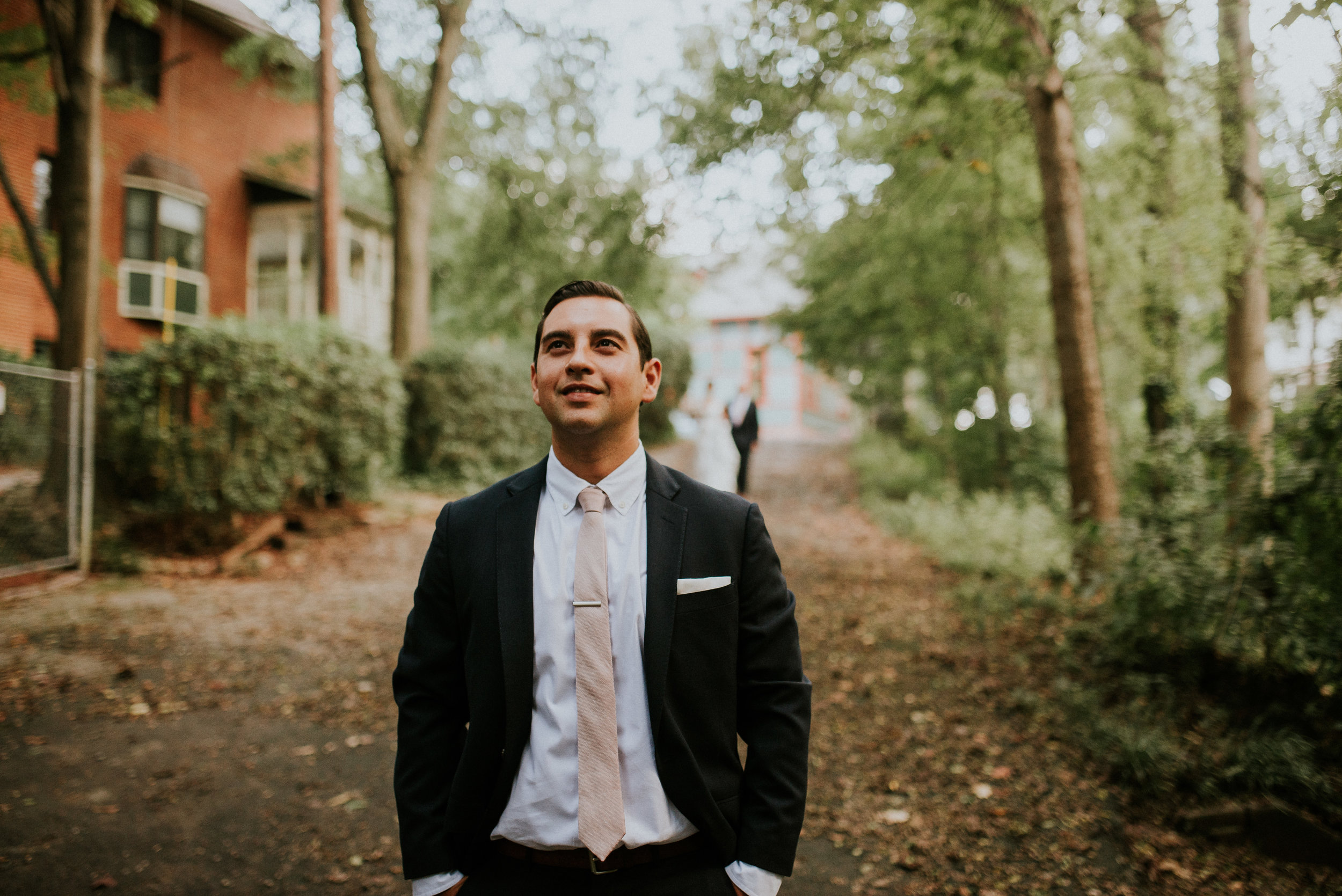 Groom anticipating bride for first look at The Trolley Barn in Atlanta, GA