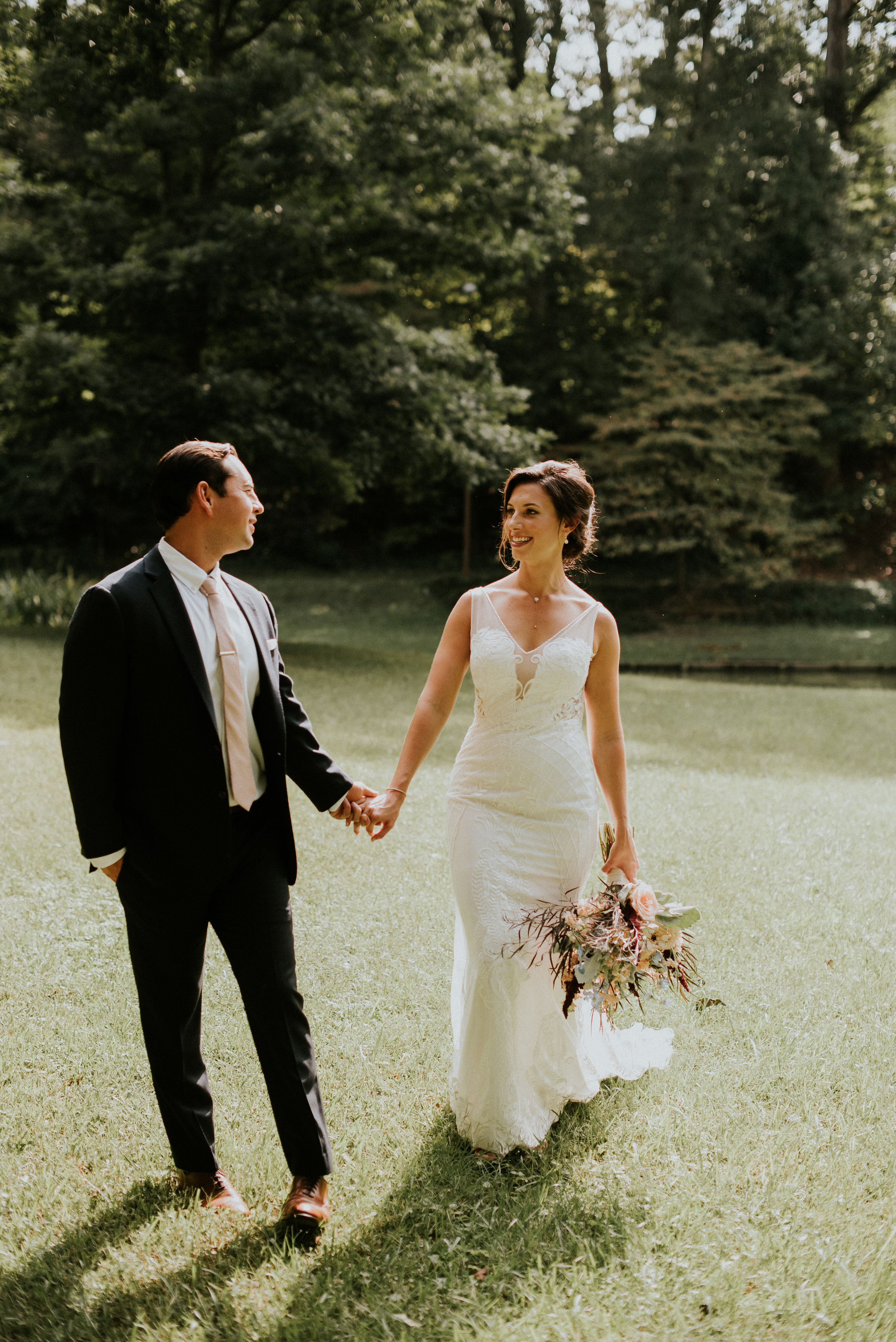 Bride and groom holding hands in Inman Park, Atlanta, GA