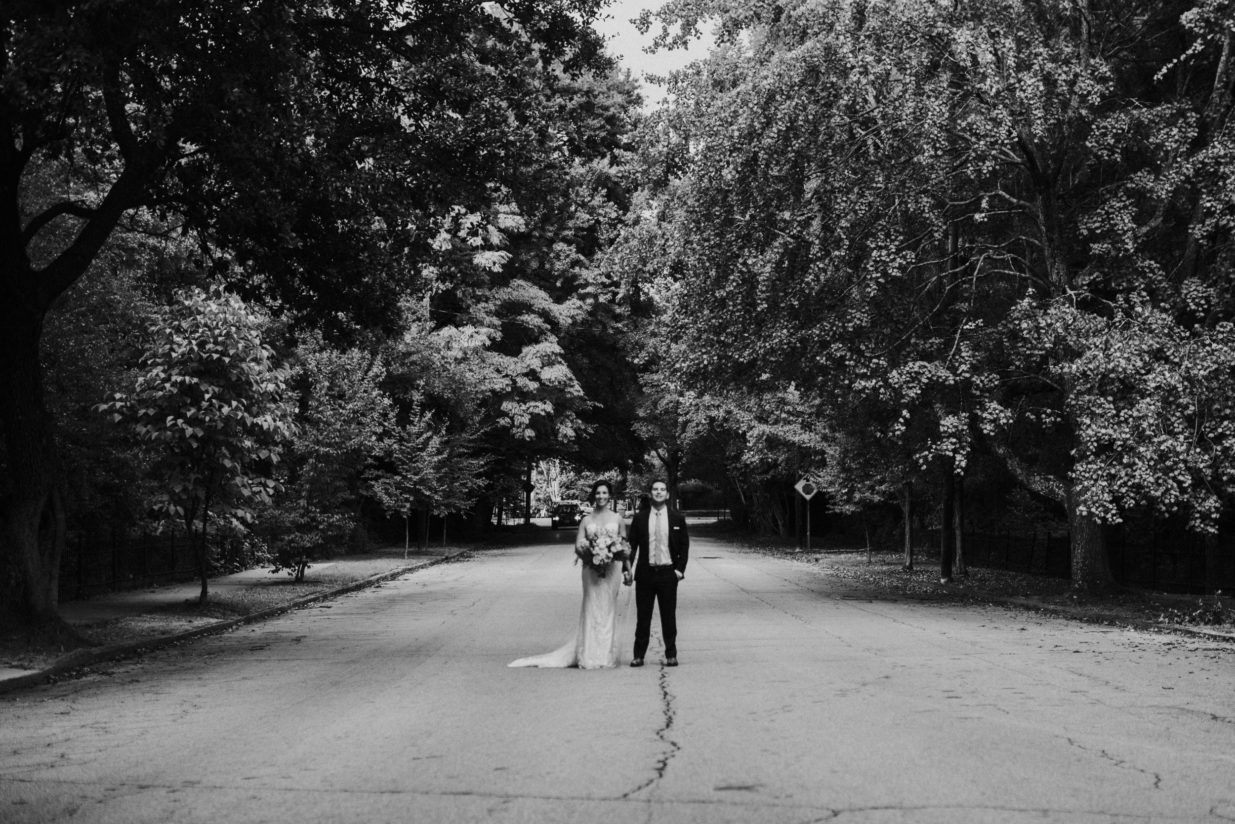 Newlywed couple standing in the street at The Trolley Barn in Atlanta, GA