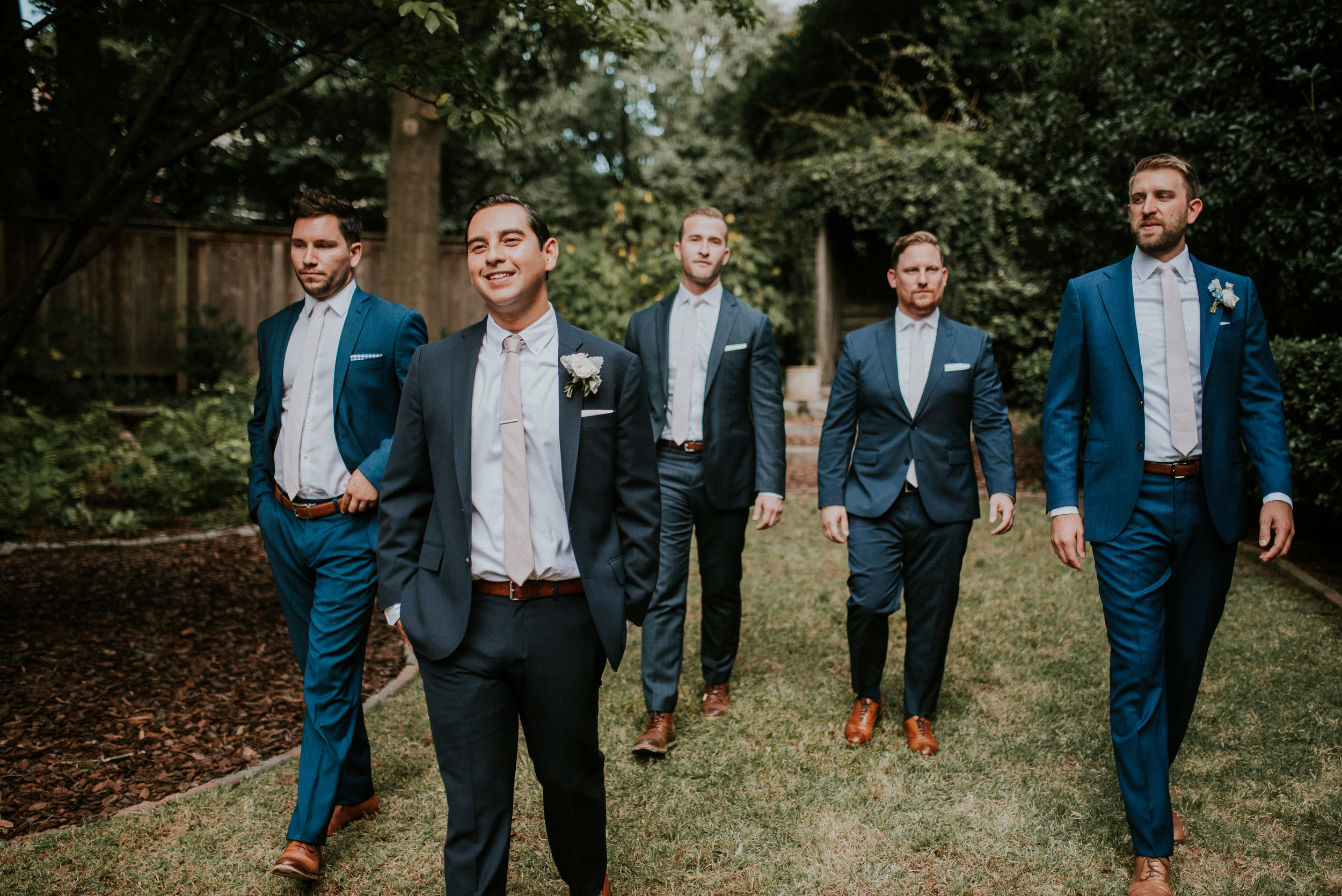 Groom and groomsmen in navy suits at The Trolley Barn