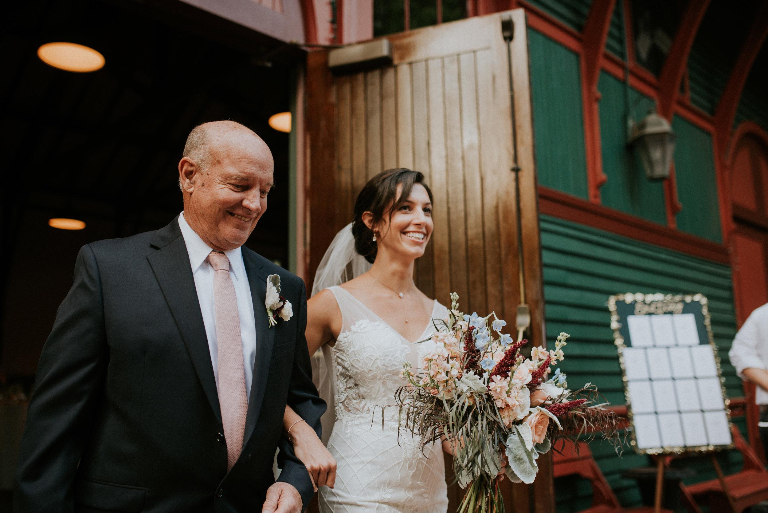 Bride walking down the aisle at The Trolley Barn in Atlanta, GA