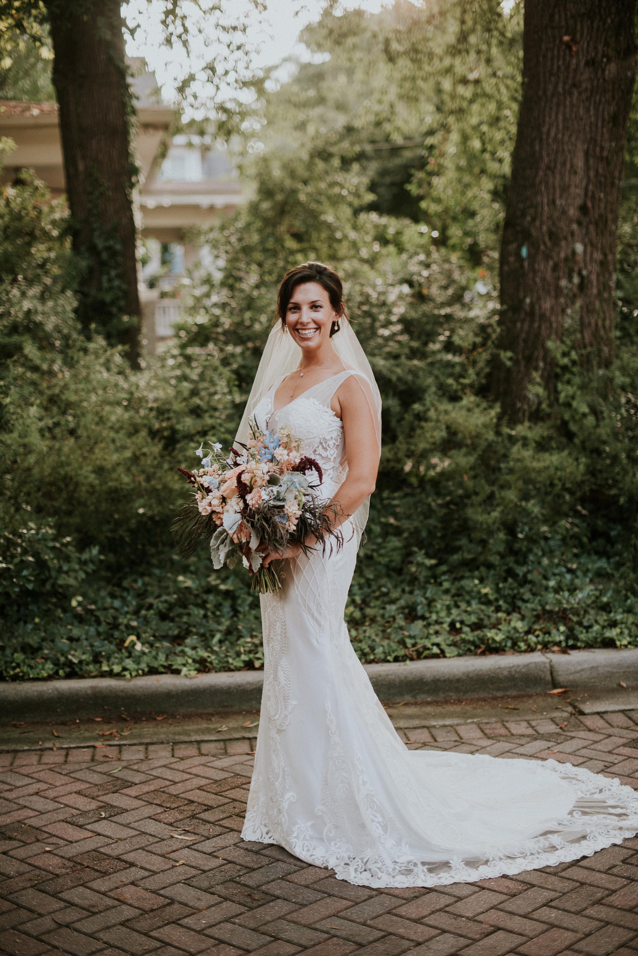 Portrait of bride in Simply Bridal wedding dress