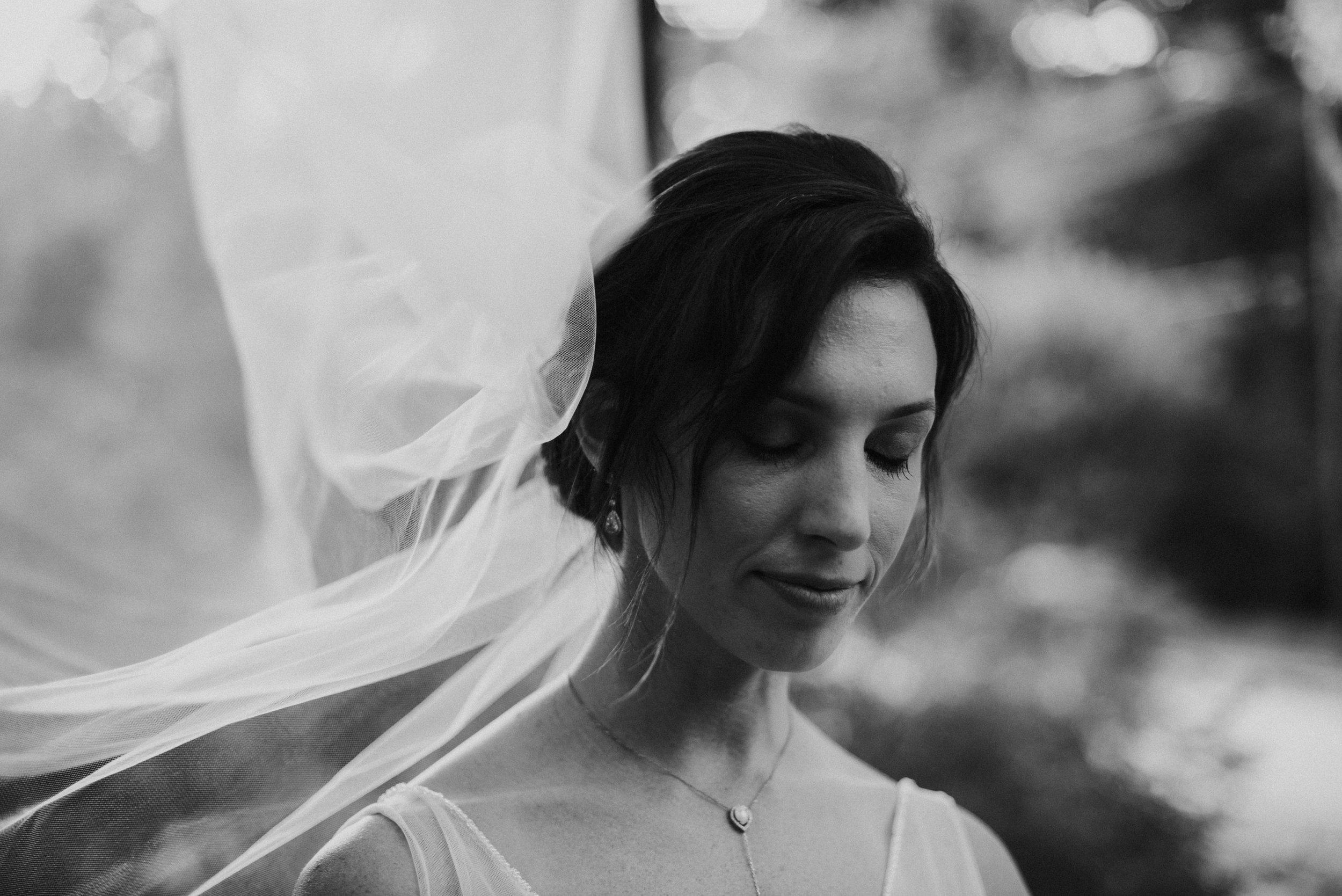 Bridal portrait with windblown veil