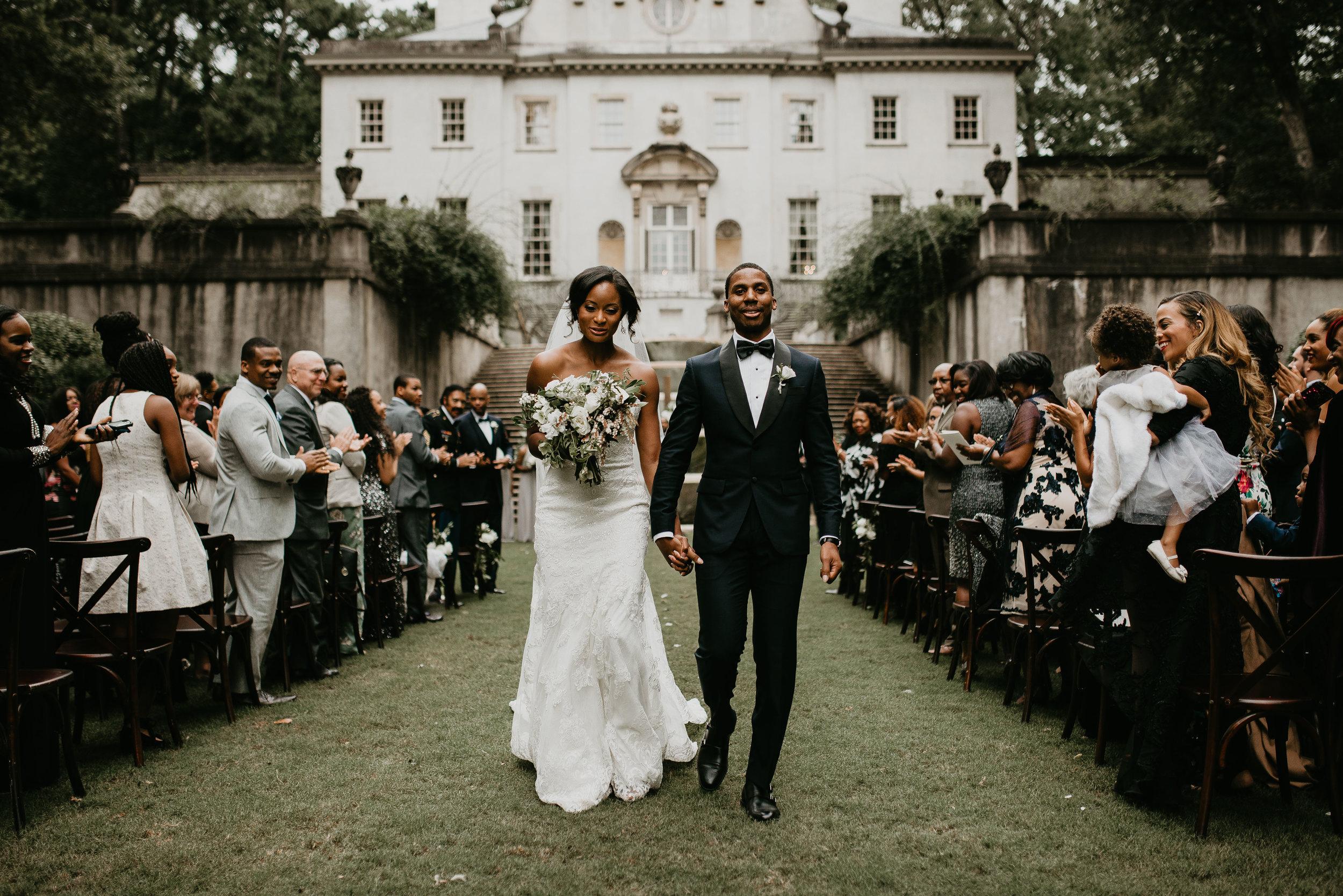 Bride and groom exit at Swan House Atlanta wedding