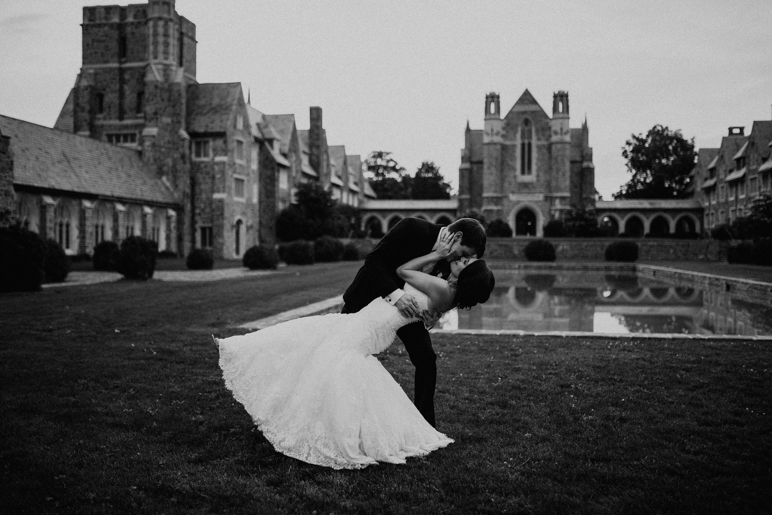 Bride and groom dip kiss on lawn at Berry College in Rome, GA