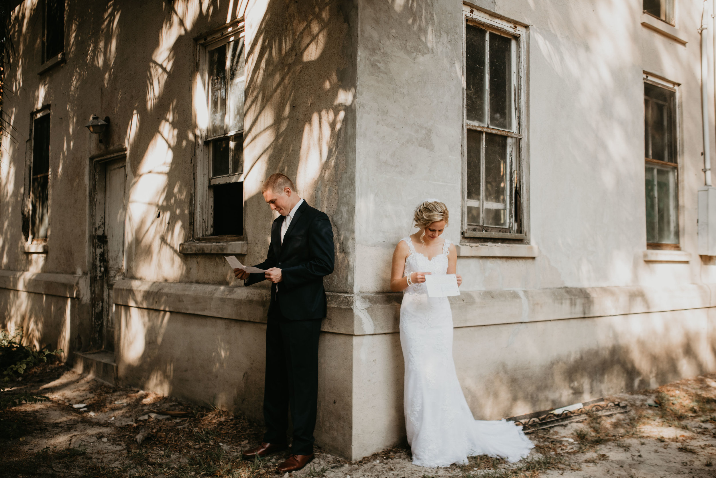 Bride and groom reading love letters at Sydonie Mansion in Mt. Dora, FL