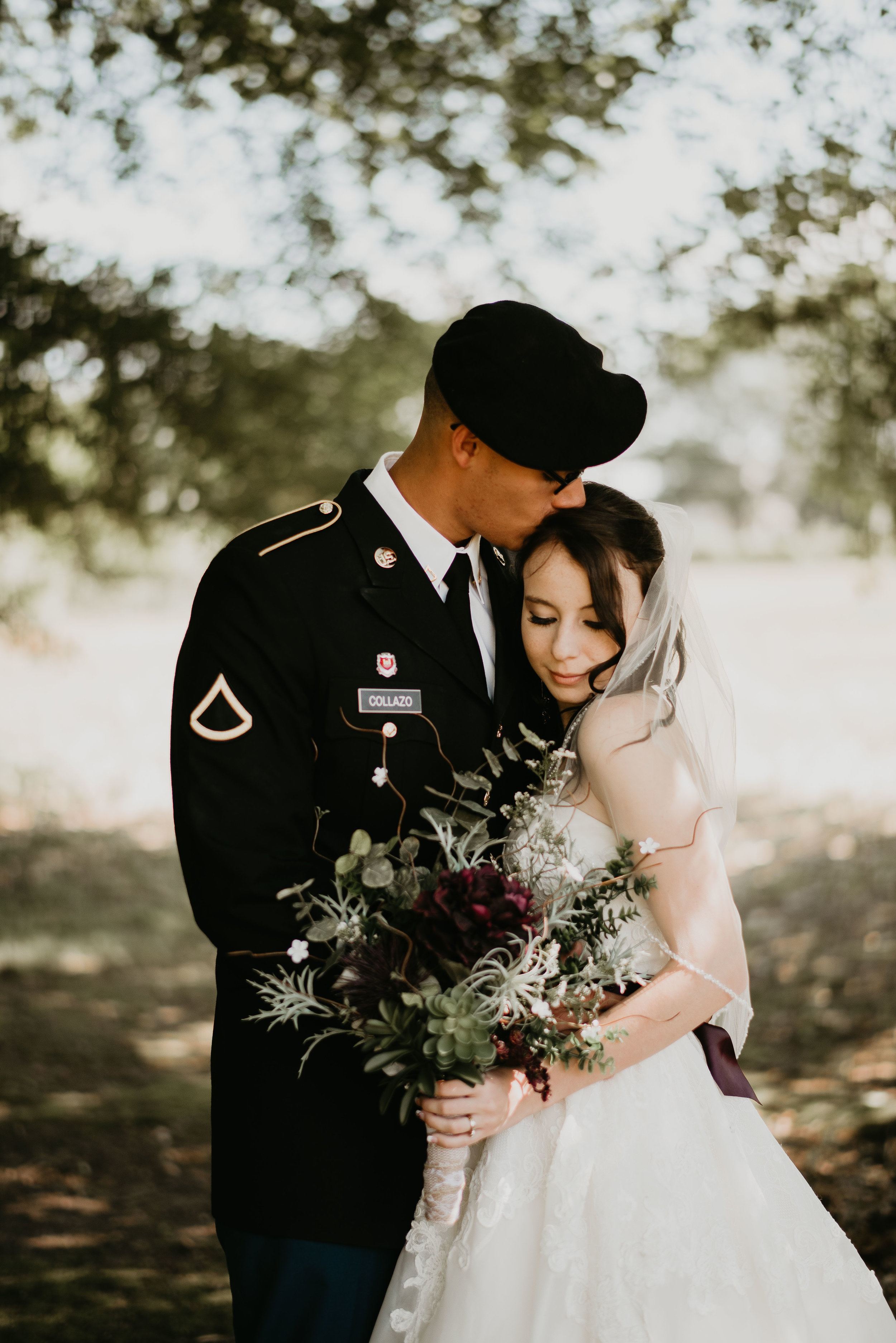 Military bride and groom kiss