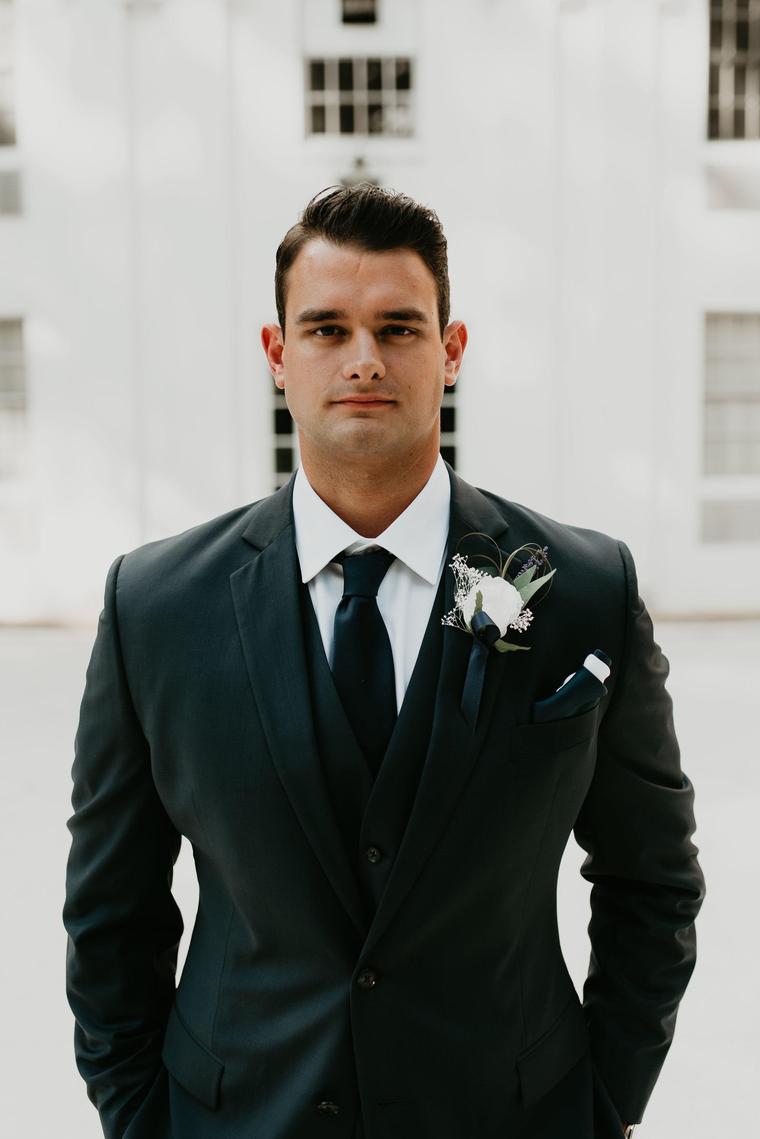 Portrait of groom in navy suit at Wesleyan College in Macon, GA