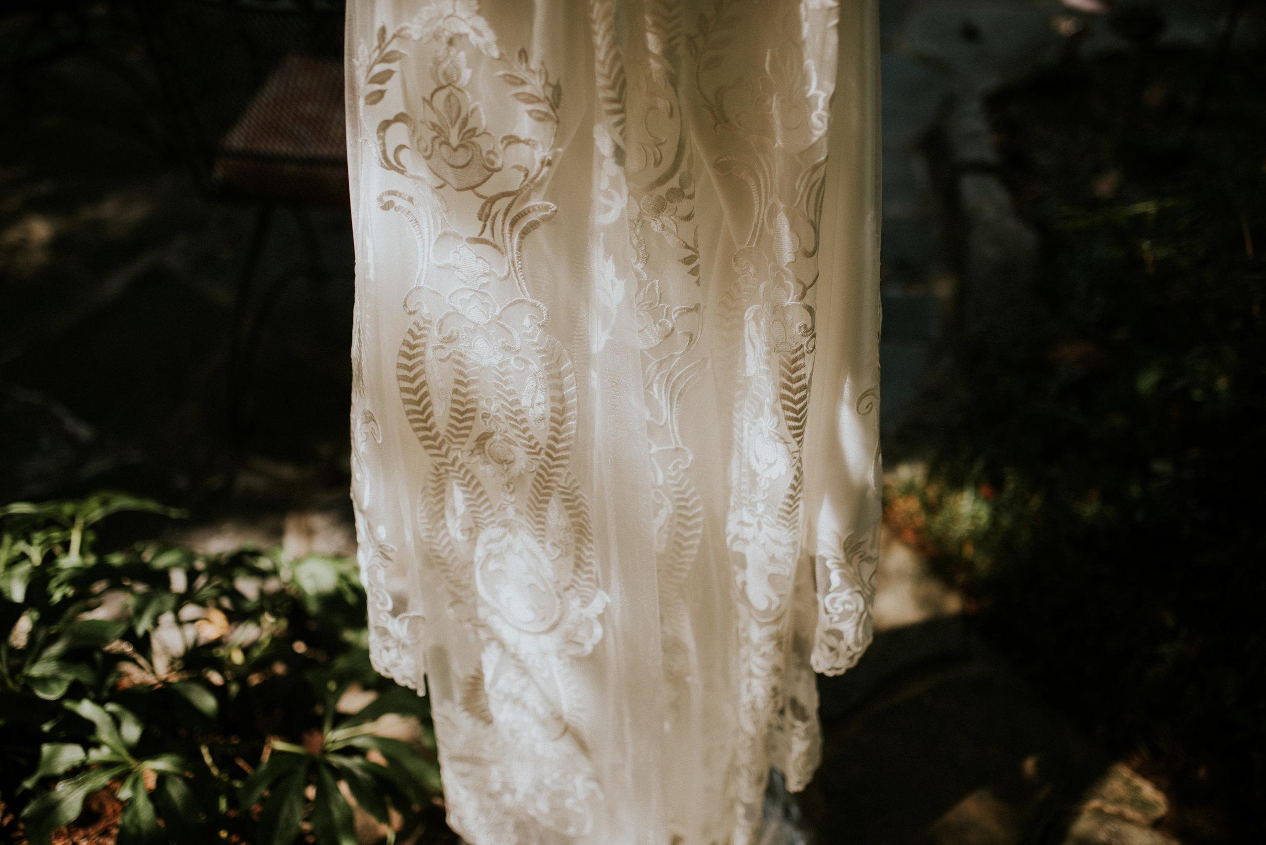 Wedding dress hanging with shadows