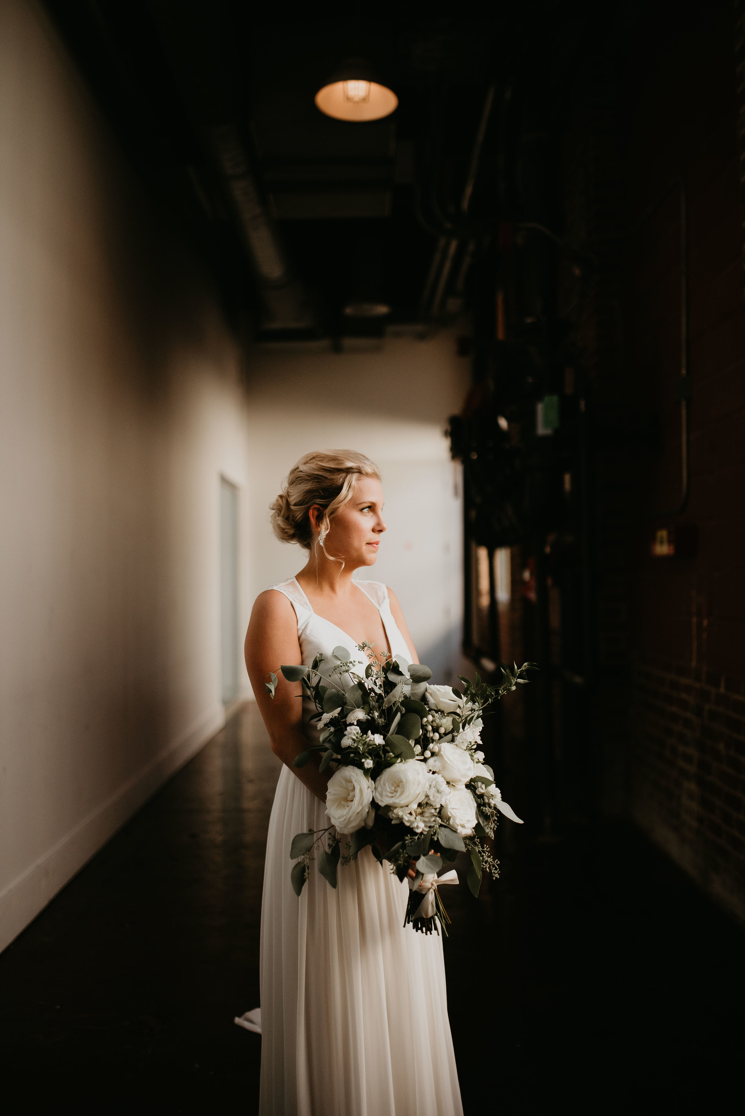 Portrait of bride with eucalyptus bouquet at The Foundry at Puritan Mill in Atlanta