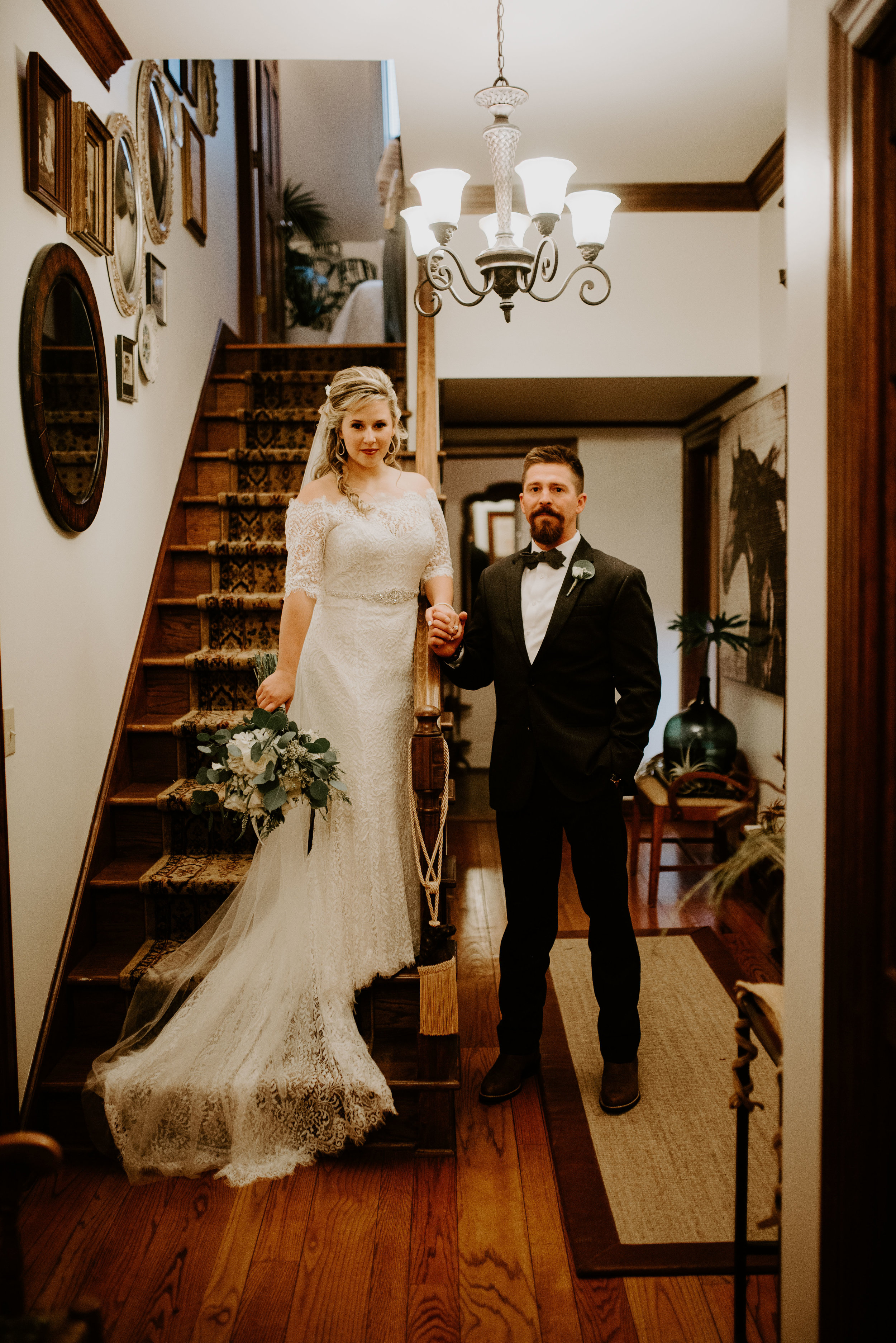 Bride and groom on staircase at Sweet Meadow Farms in Tallapoosa, GA