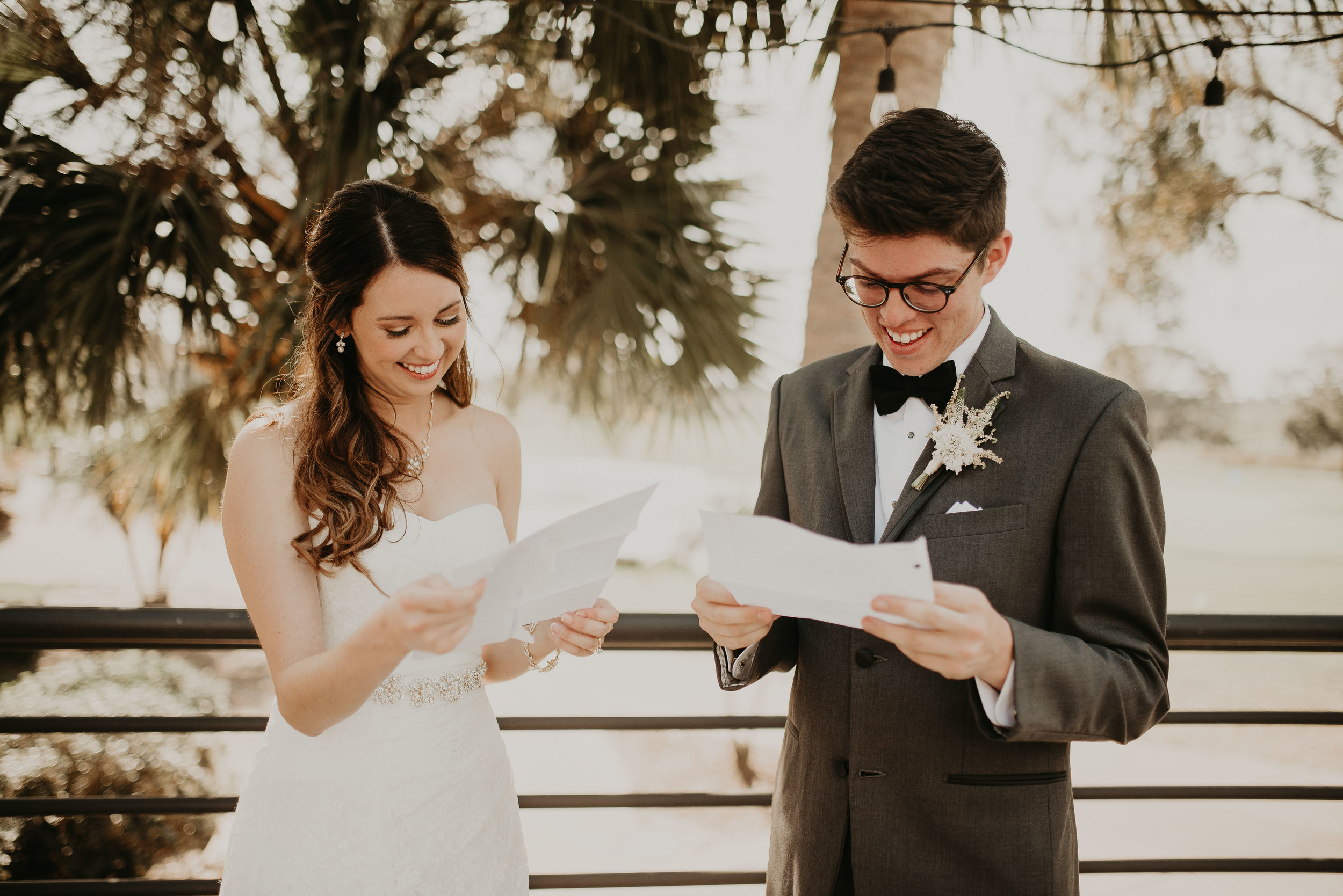 Bride and groom read love letters at MetroWest Golf Club in Orlando, FL