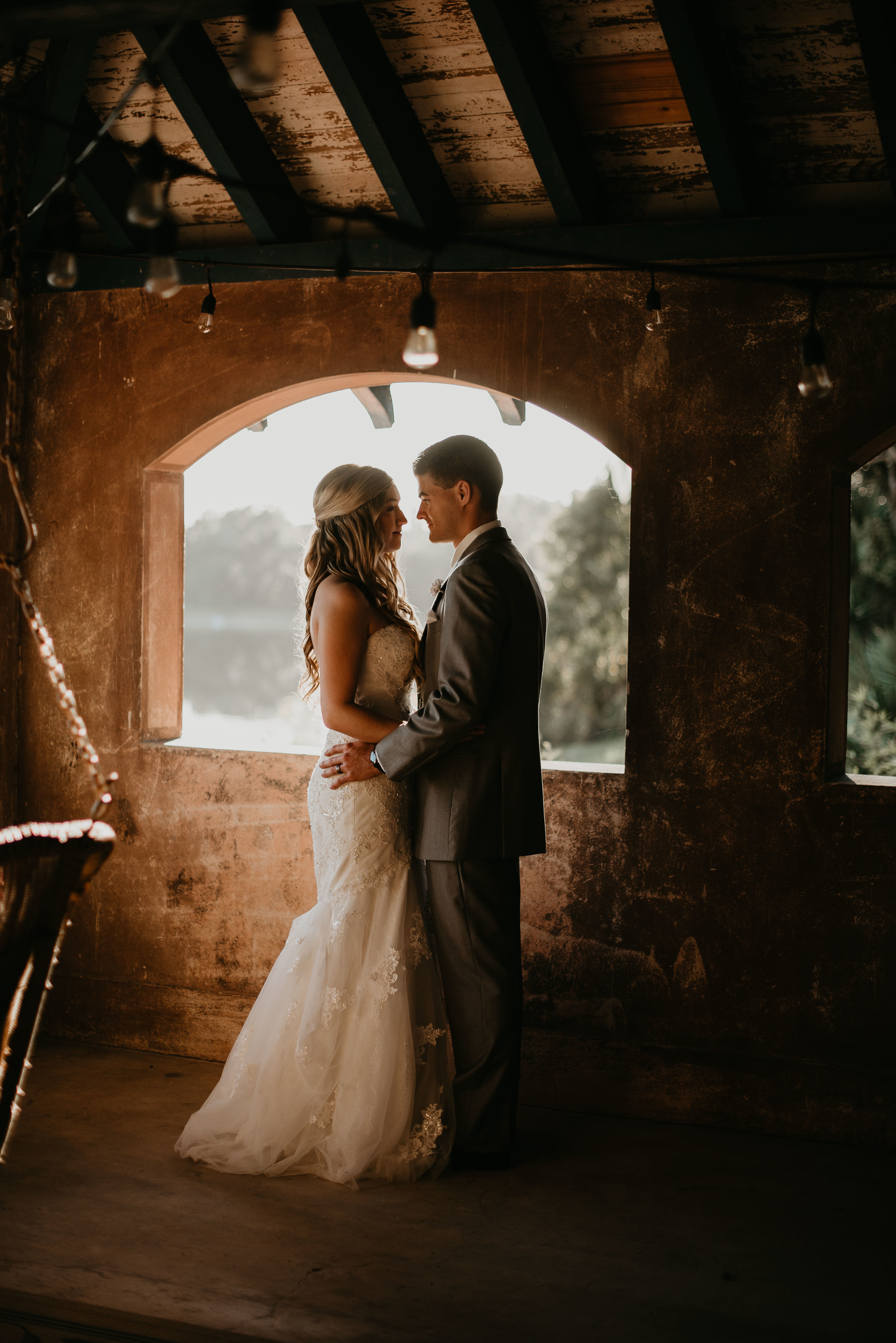 Bride and groom holding each other during sunset at Sydonie Mansion in Mt. Dora, FL