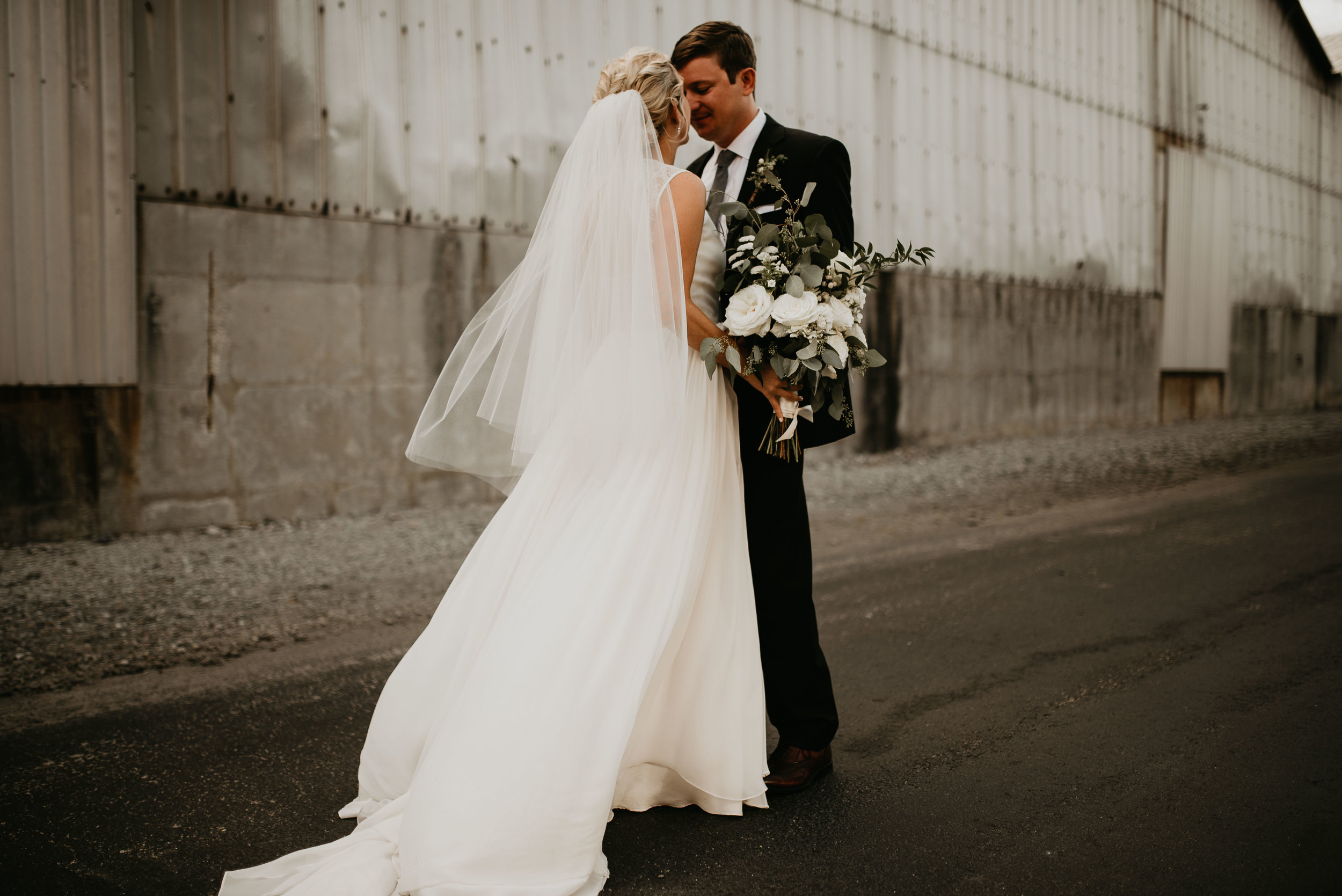 Bride and groom close together at The Foundry at Puritan Mill in Atlanta, GA