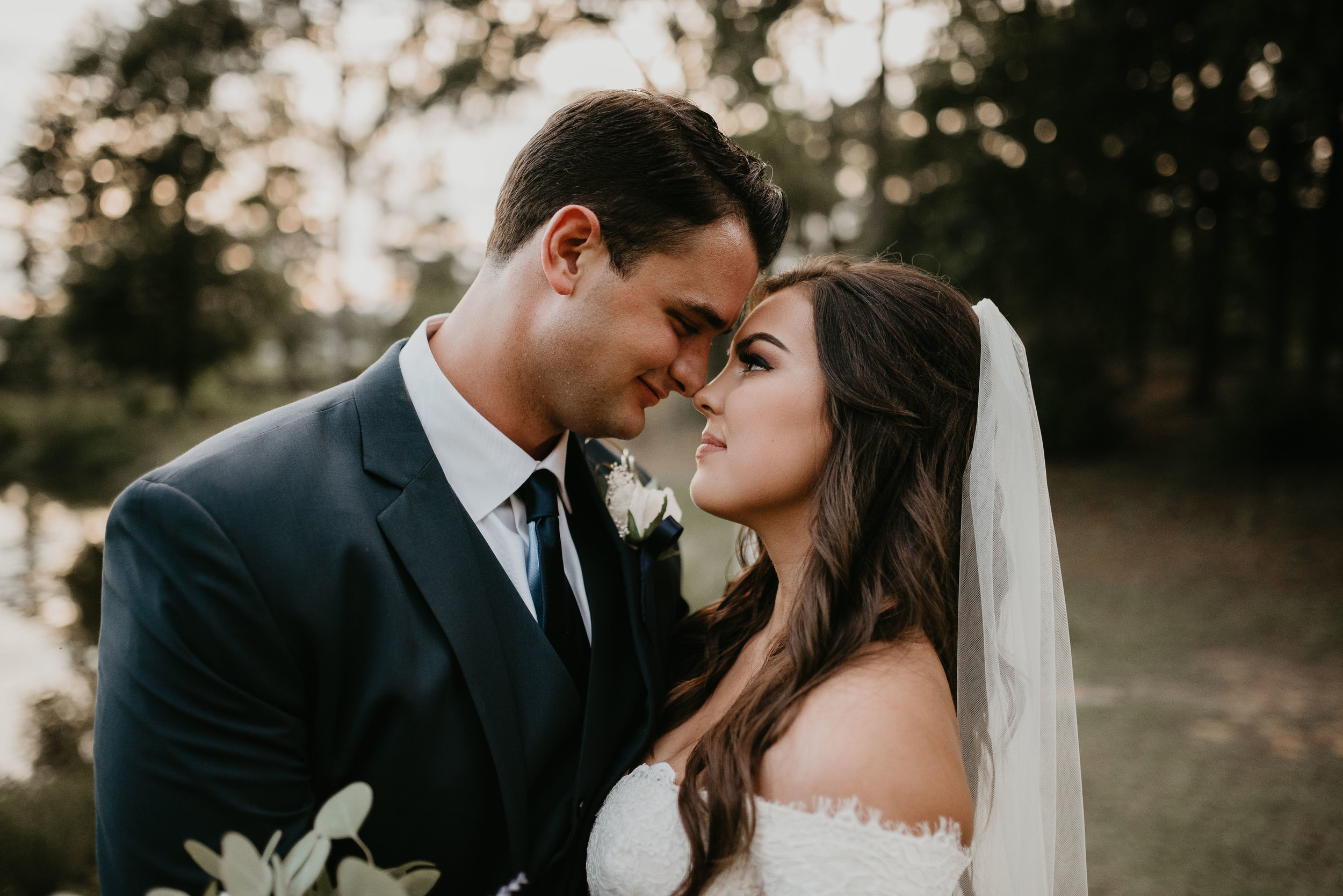 Bride and groom stare into each others eyes at Wesleyan College in Maceon, GA