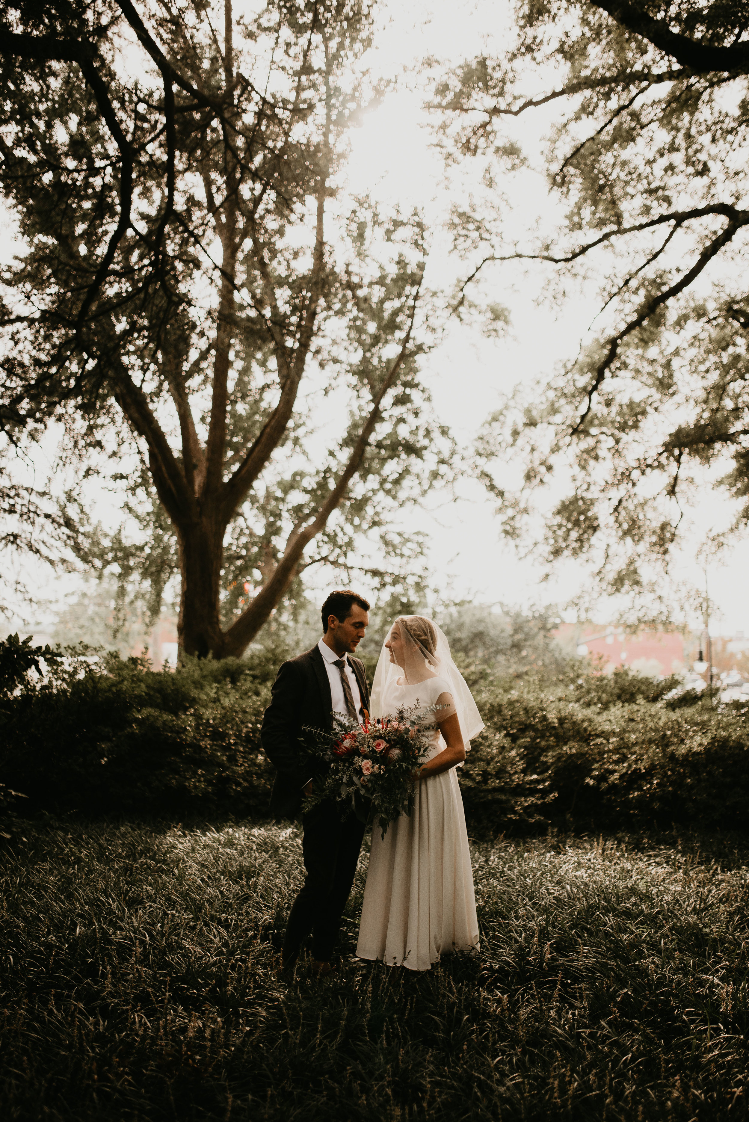 Bride and groom surrounded by greenery in Columbia, SC