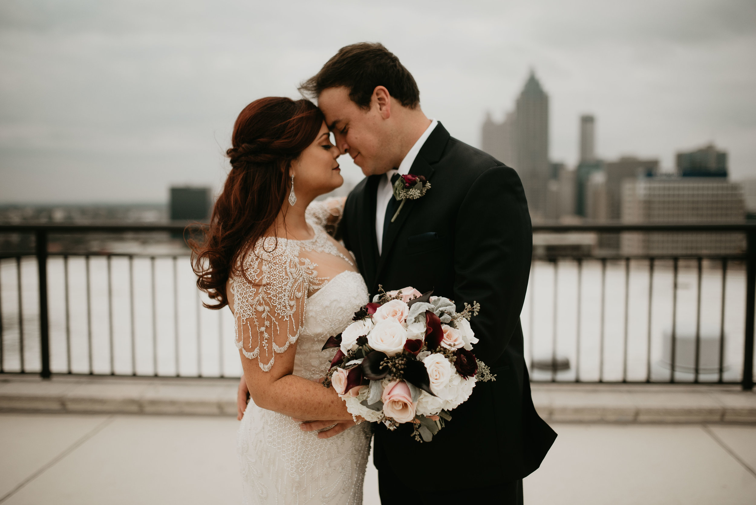 Bride and groom nose-to-nose at the Georgian Terrace roof in Atlanta, GA