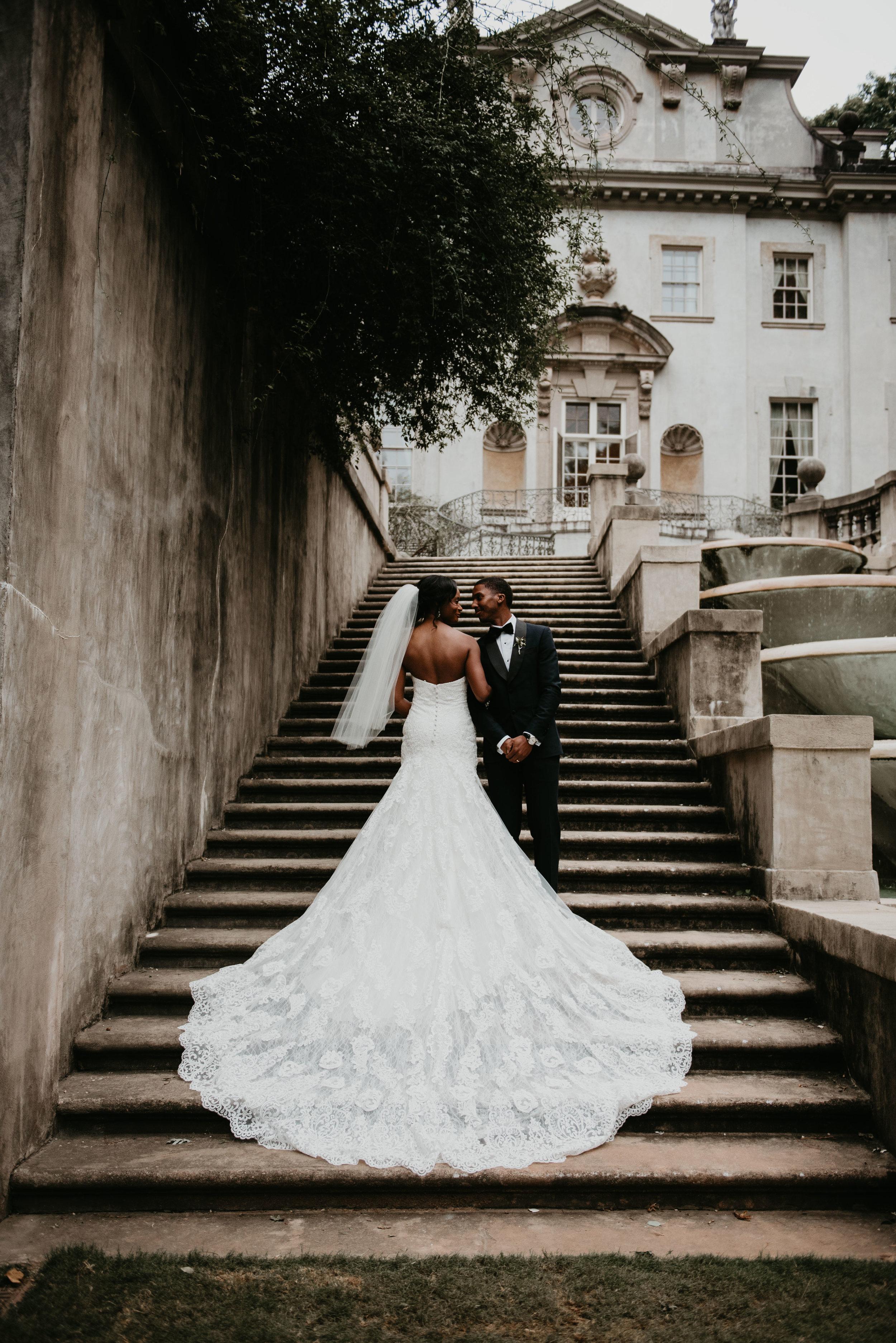 Bride's wedding dress train covering steps at Swan House in Atlanta, GA