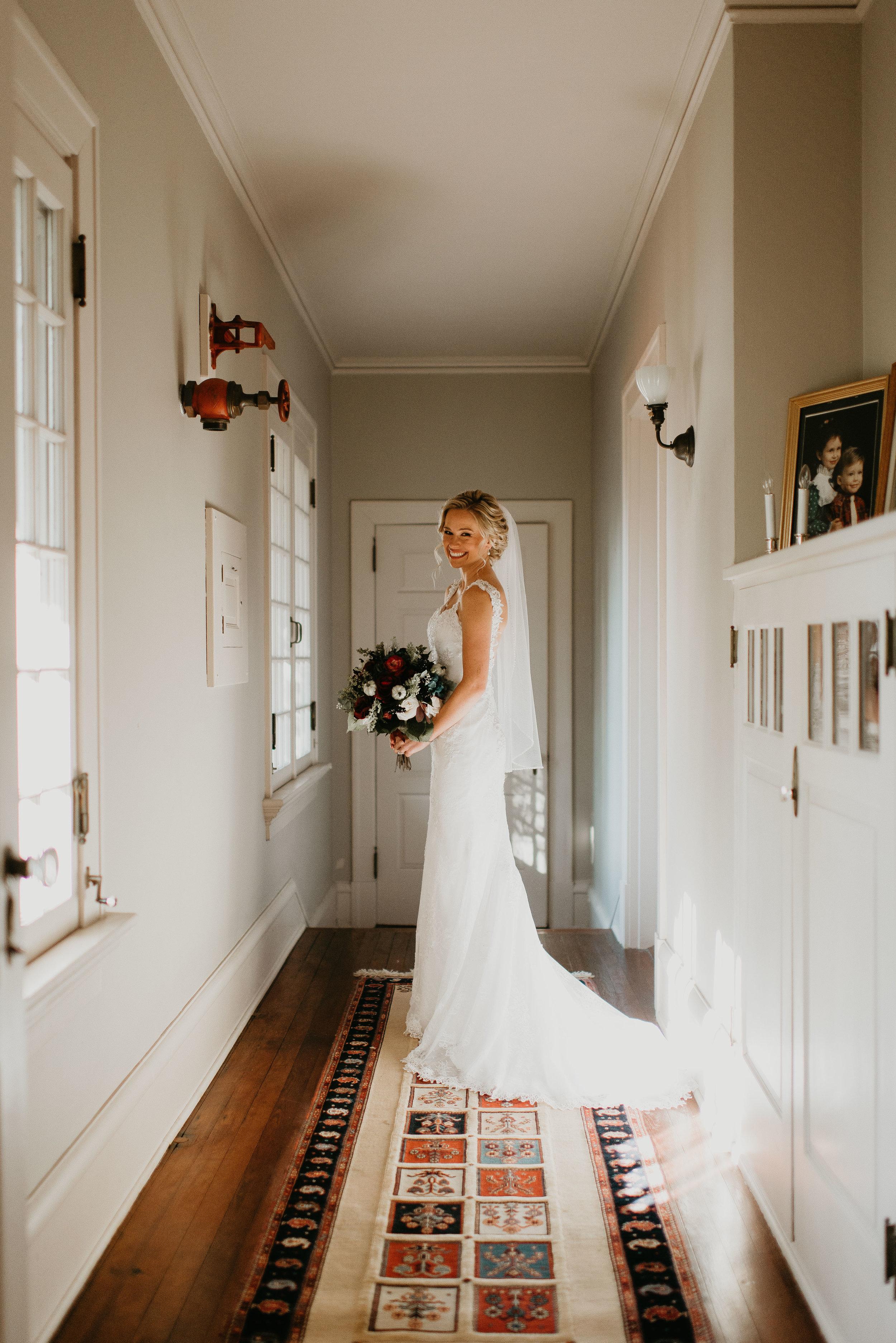 Portrait of bride holding bouquet inside Sydonie Mansion in Mt. Dora, FL