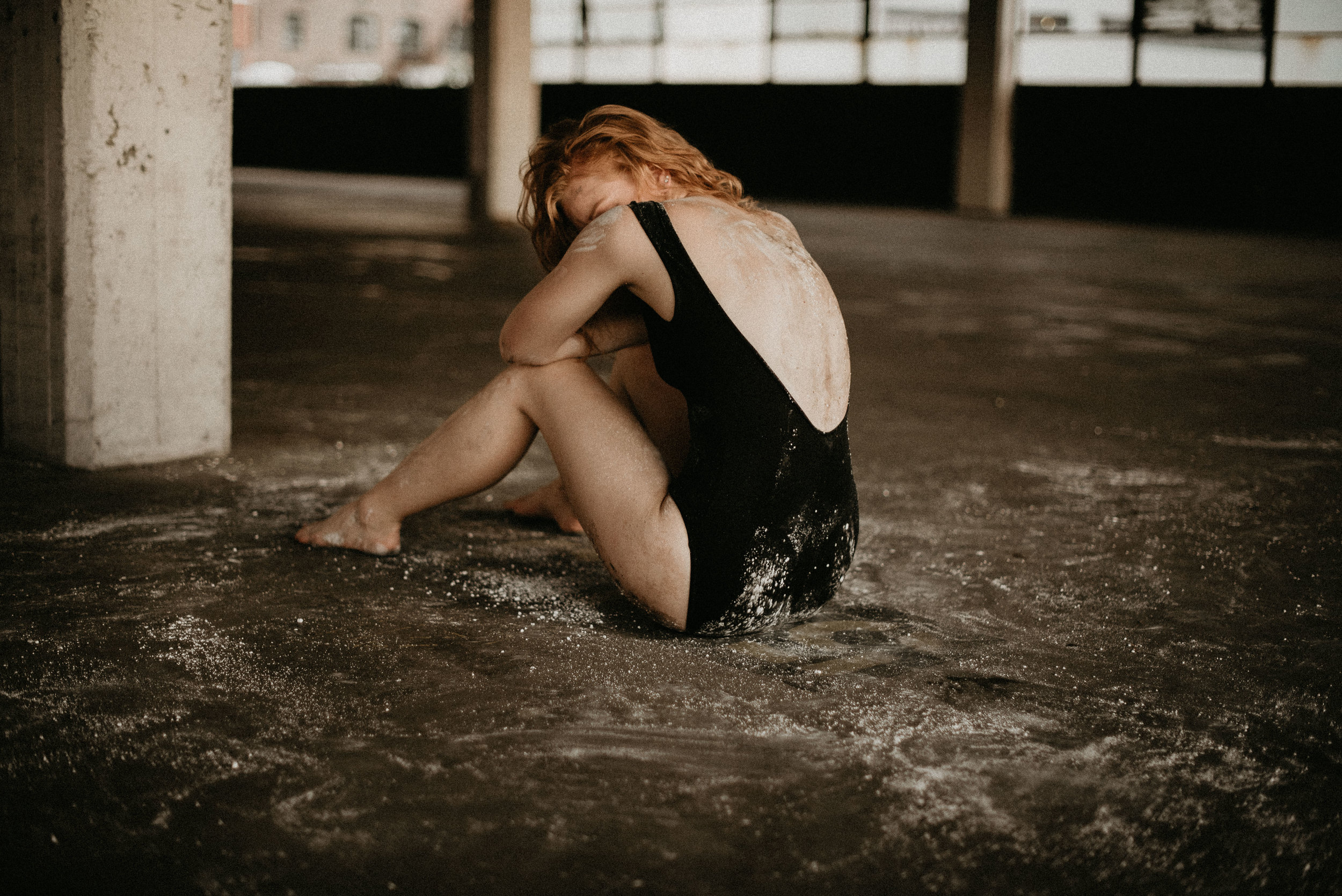ballet model sits in chalk at styled creative session in atlanta parking garage