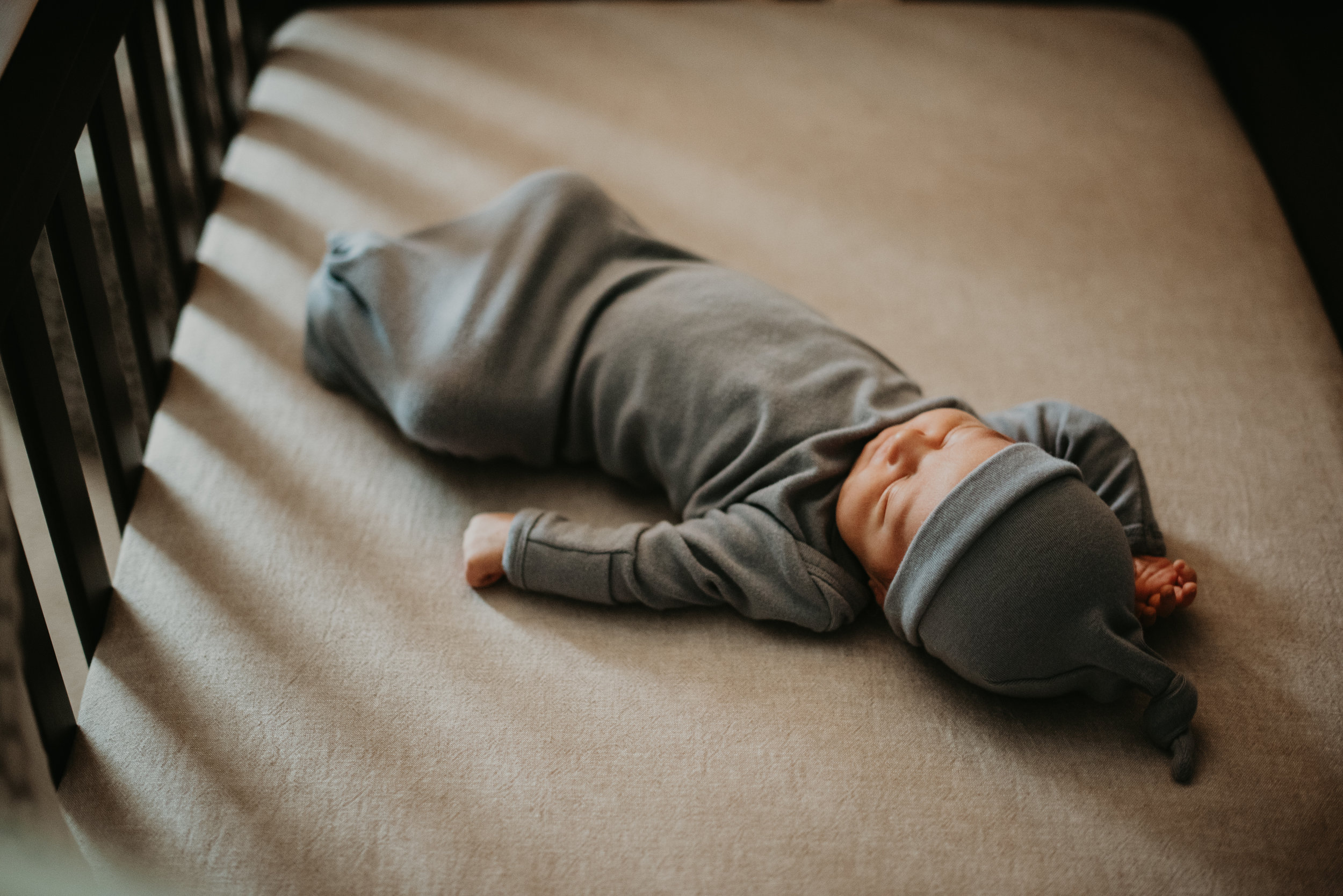 newborn baby boy lays in crib for in-home photos atlanta